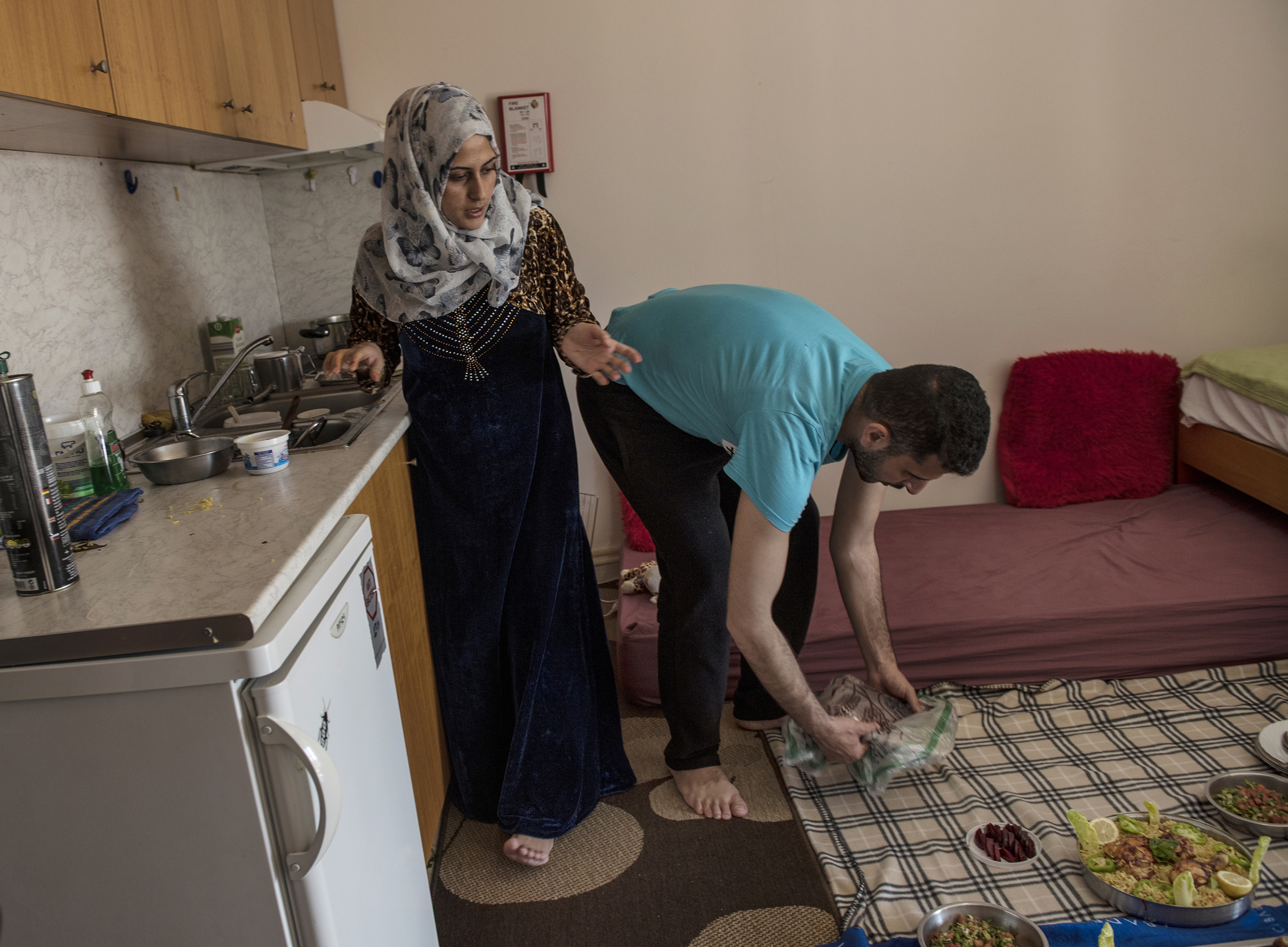 Noor Al Talaa, 22, and her husband, Yousuf Arsan, 27, prepare lunch at home with baby Rahaf, almost 6 months, at an apartment in Sidros, outside of Thessaloniki, Greece, March 28, 2017.