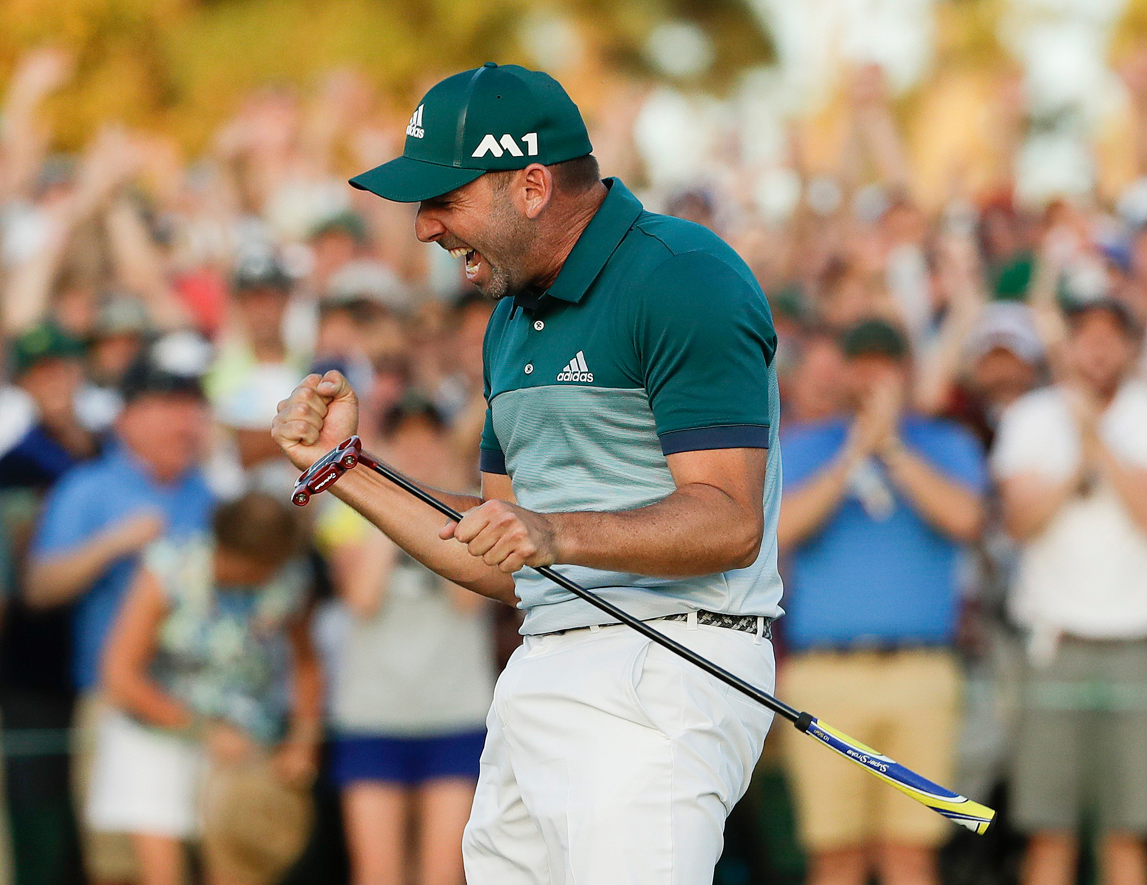 Sergio Garcia, of Spain, reacts after making his birdie putt on the 18th green to win the Masters golf tournament after a playoff on April 9, 2017, in Augusta.