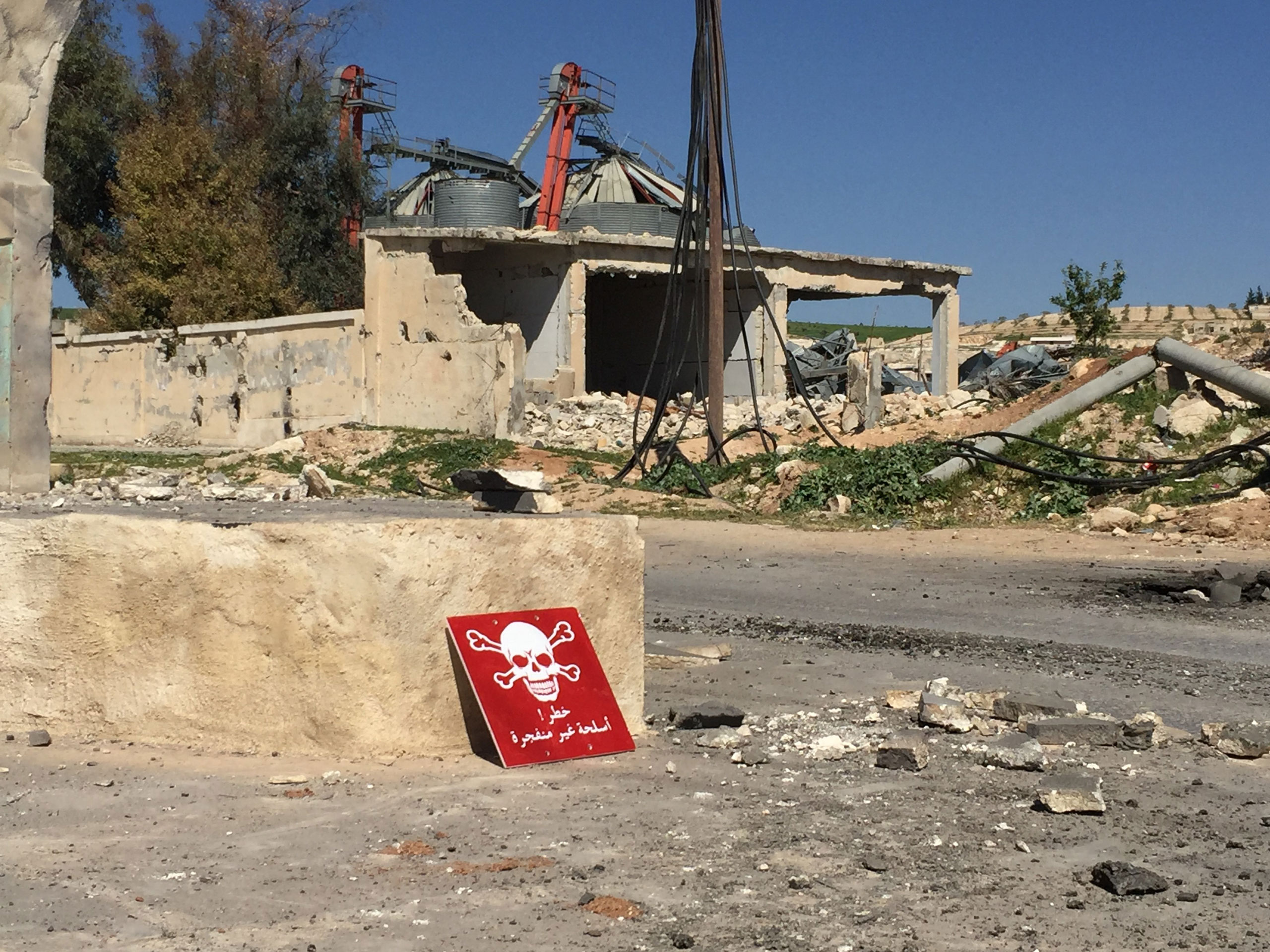 A poison hazard danger sign is seen in the town of Khan Shaykun, Idlib province, Syria on April 5, 2017.
