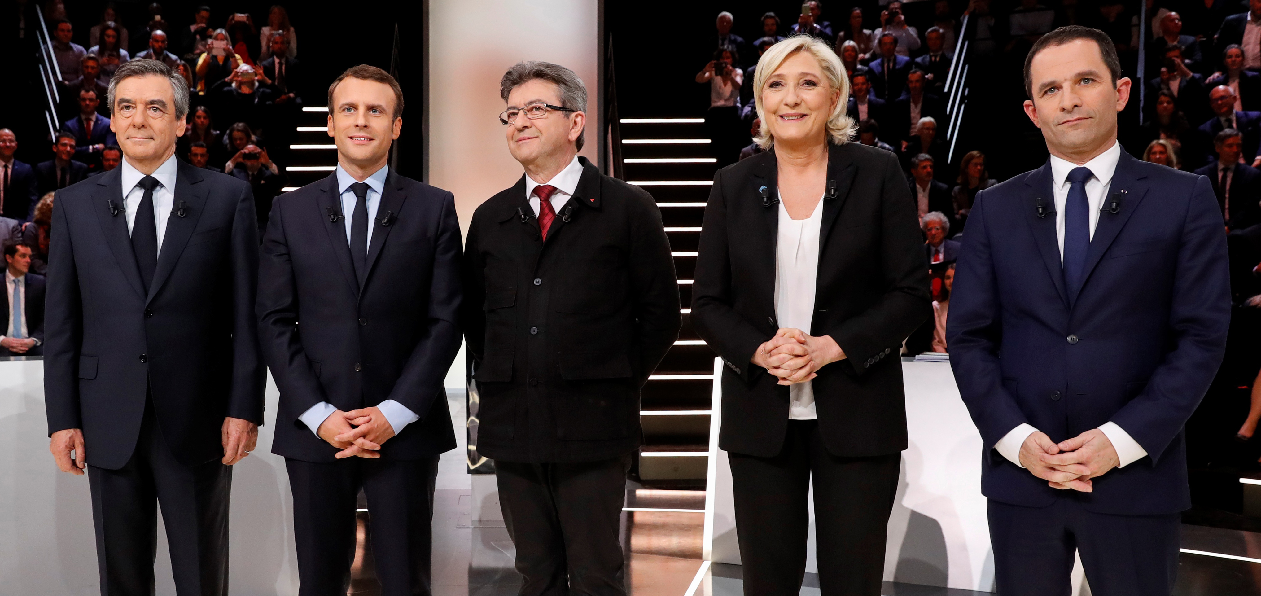 (L to R) French presidential election candidates, right-wing Les Republicains (LR) party Francois Fillon, En Marche! movement Emmanuel Macron, far-left coalition La France insoumise Jean-Luc Melenchon, far-right National Front's Marine Le Pen, and left-wing French Socialist party Benoit Hamon, pose before a debate organised by the French private TV channel TF1 on March 20, 2017 in Aubervilliers, outside Paris.
