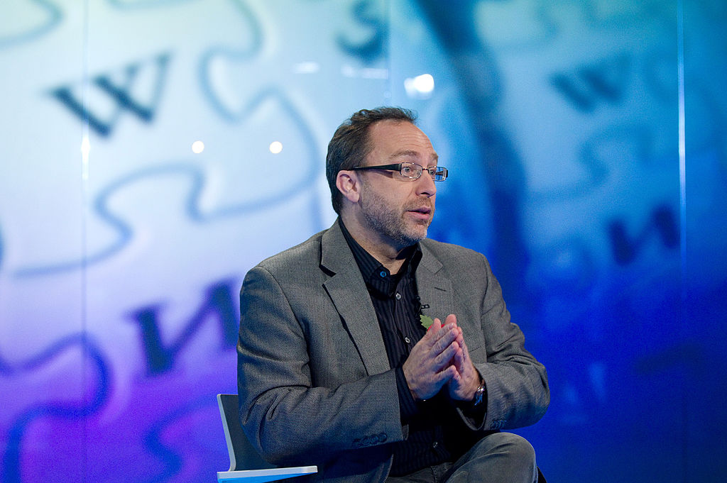 Jimmy Wales, co-founder of Wikipedia, gestures during a television interview in London, U.K., on Monday, Nov. 7, 2011. To keep the online encyclopedia free and without advertising, Wikimedia Foundation Inc., the non-profit organization that operates Wikipedia, has held funderaisers since 2005. Photographer: Simon Dawson/Bloomberg via Getty Images