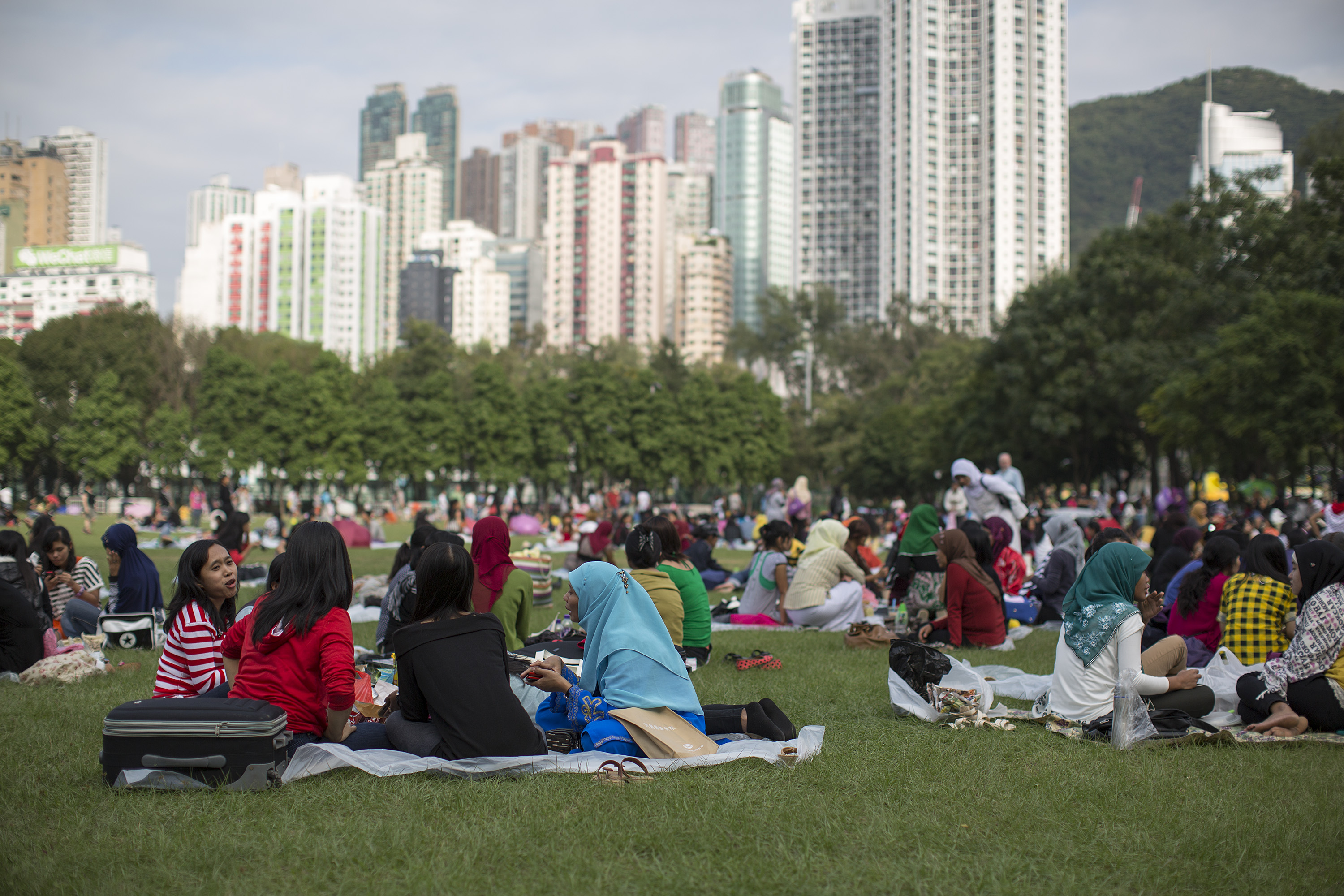 Migrant workers sit in Victoria Park on their day off in Hong Kong on Nov. 11, 2012