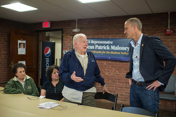 Rep. Sean Patrick Maloney, D-N.Y., talks with constituents Theresa Yantz, 79, left, her husband Larry, 81, standing, and their daughter Patricia Wenzel, 55, during a town hall in Newburgh, N.Y., on June 11, 2016.