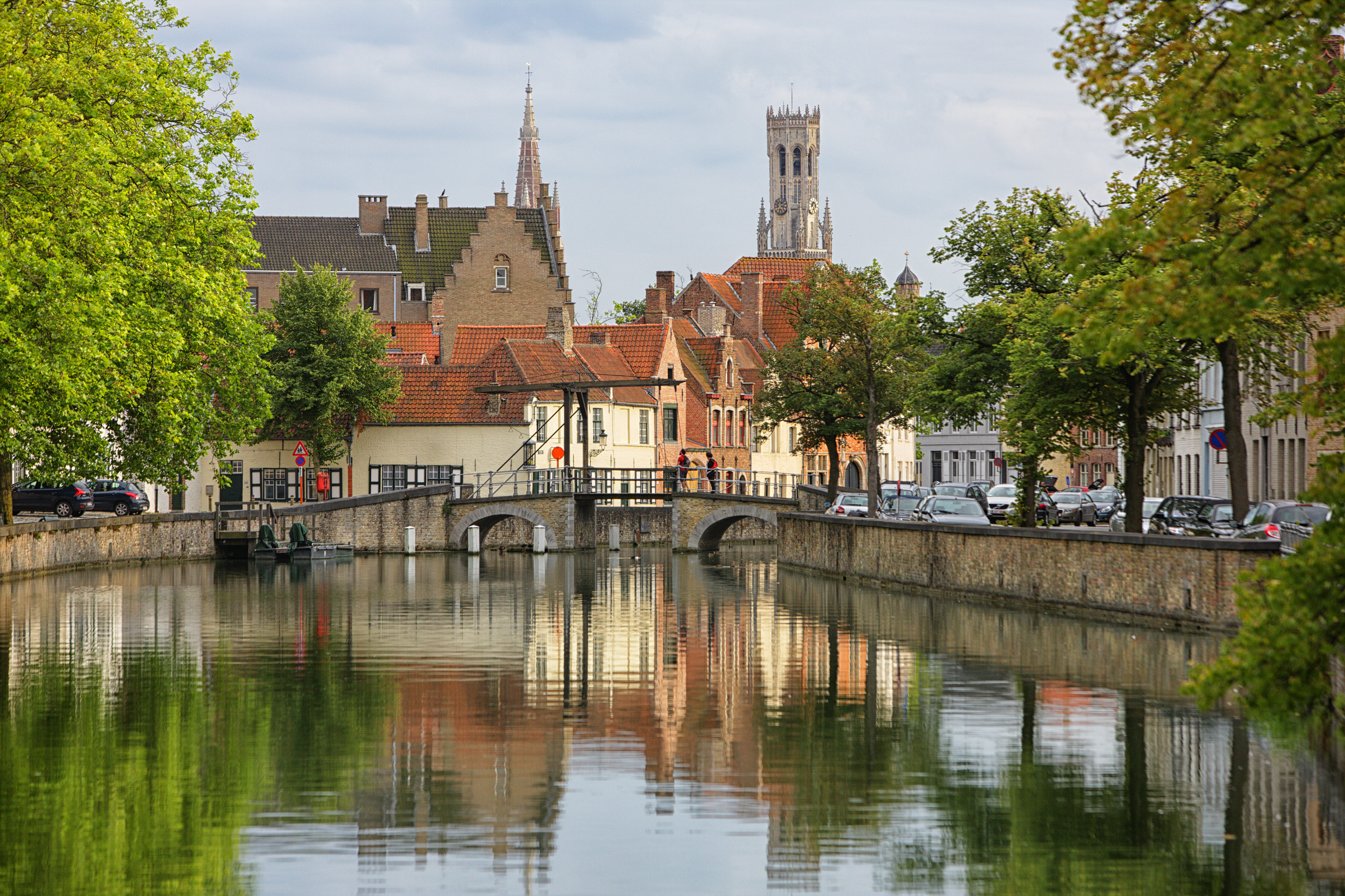 Belgium, Bruges, Churches reflecting in canals