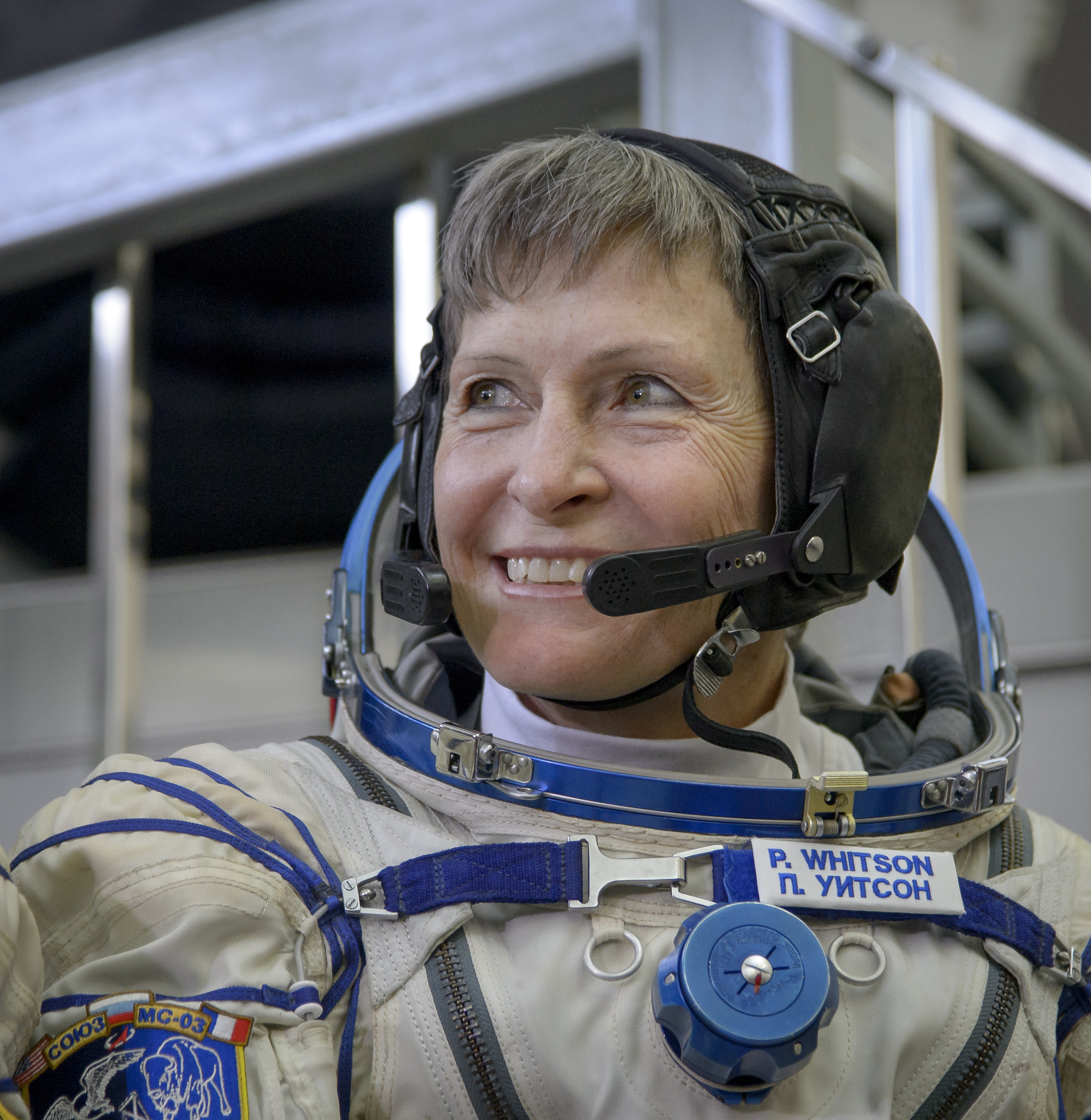 NASA astronaut Peggy Whitson smiles as she listens to a reporter's questions.