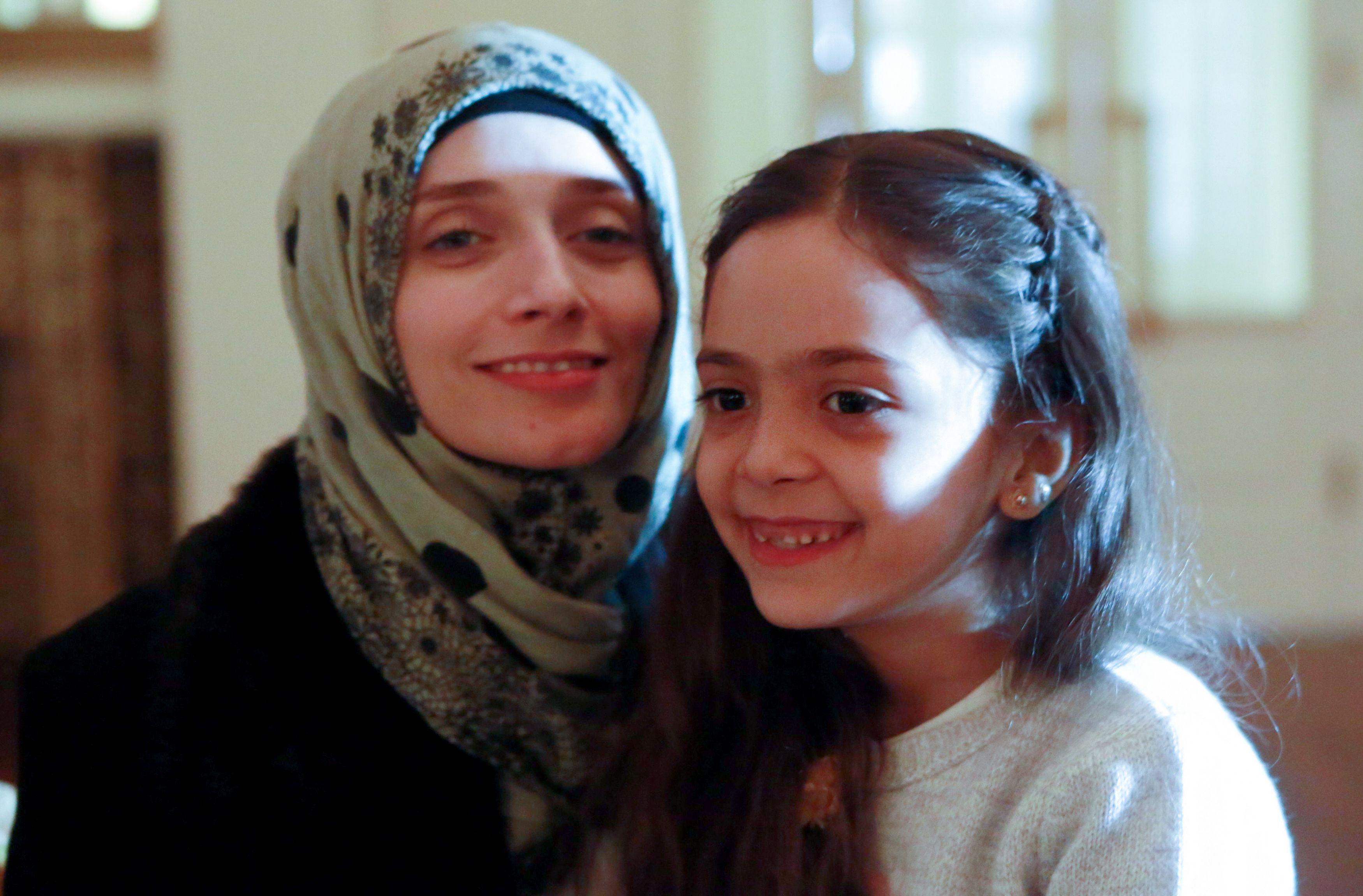 Syrian girl Bana al-Abed (R), known as Aleppo's tweeting girl, poses with her mother Fatemah during an interview in Ankara, Turkey, on December 22, 2016.