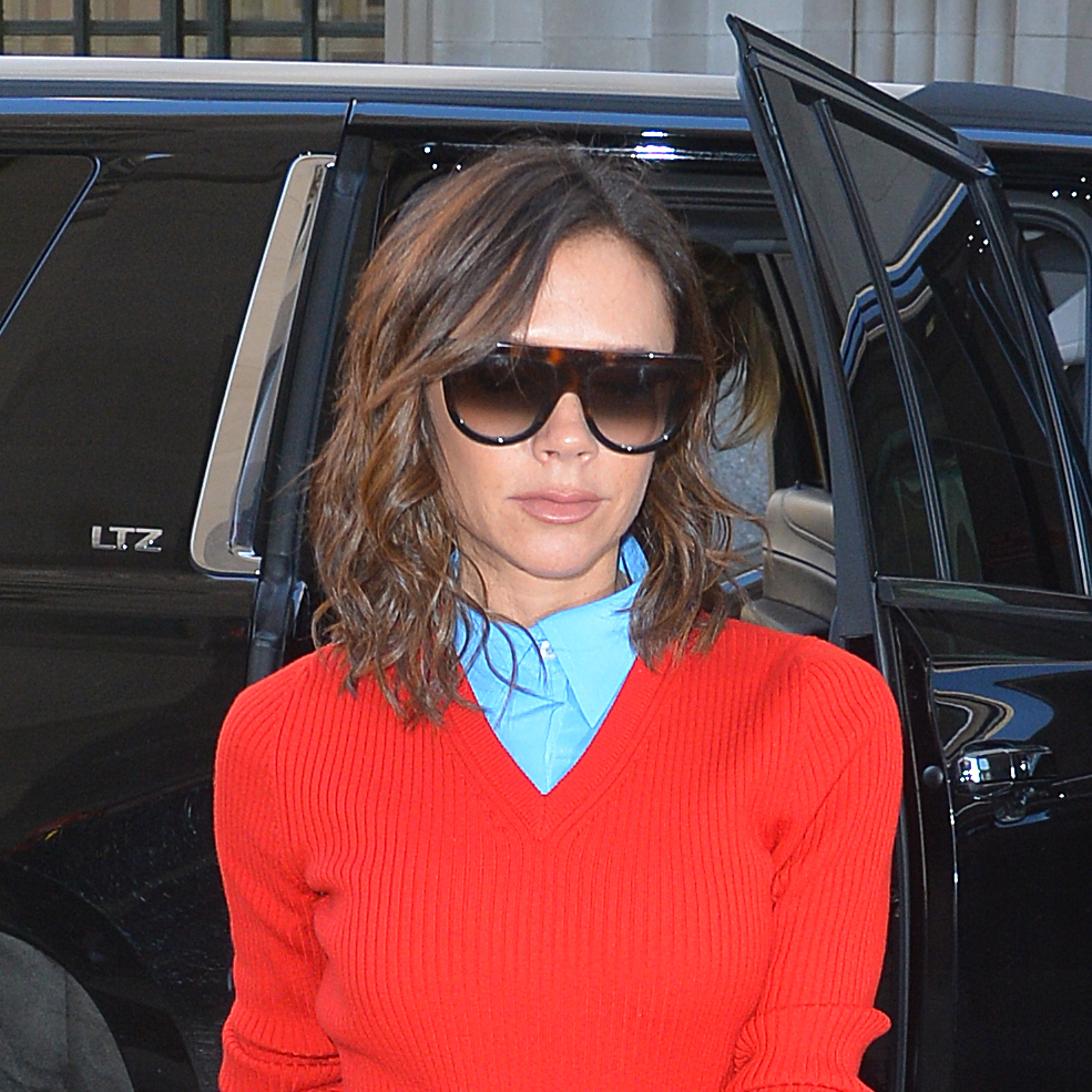 Victoria Beckham in a red ribbed knit dress, on top of a blue button-up shirt with ankle boots is seen out in Manhattan on February 06, 2017 in New York, New York.