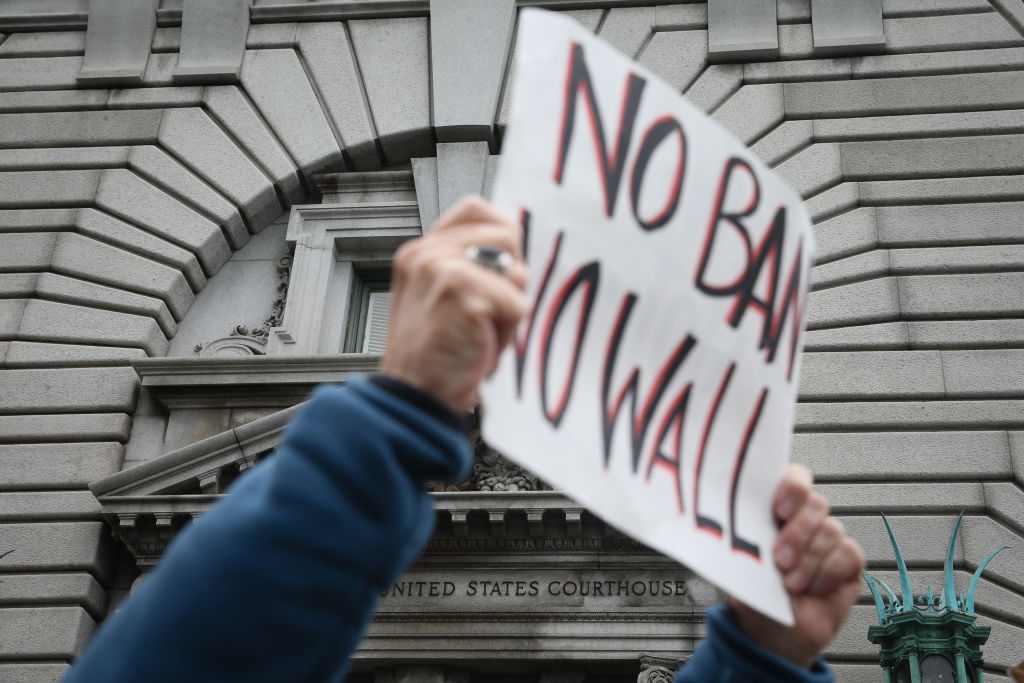 Opponents of President  Trump's travel ban order protest outside a federal appeals court Feb. 7, 2016 in San Francisco, California.