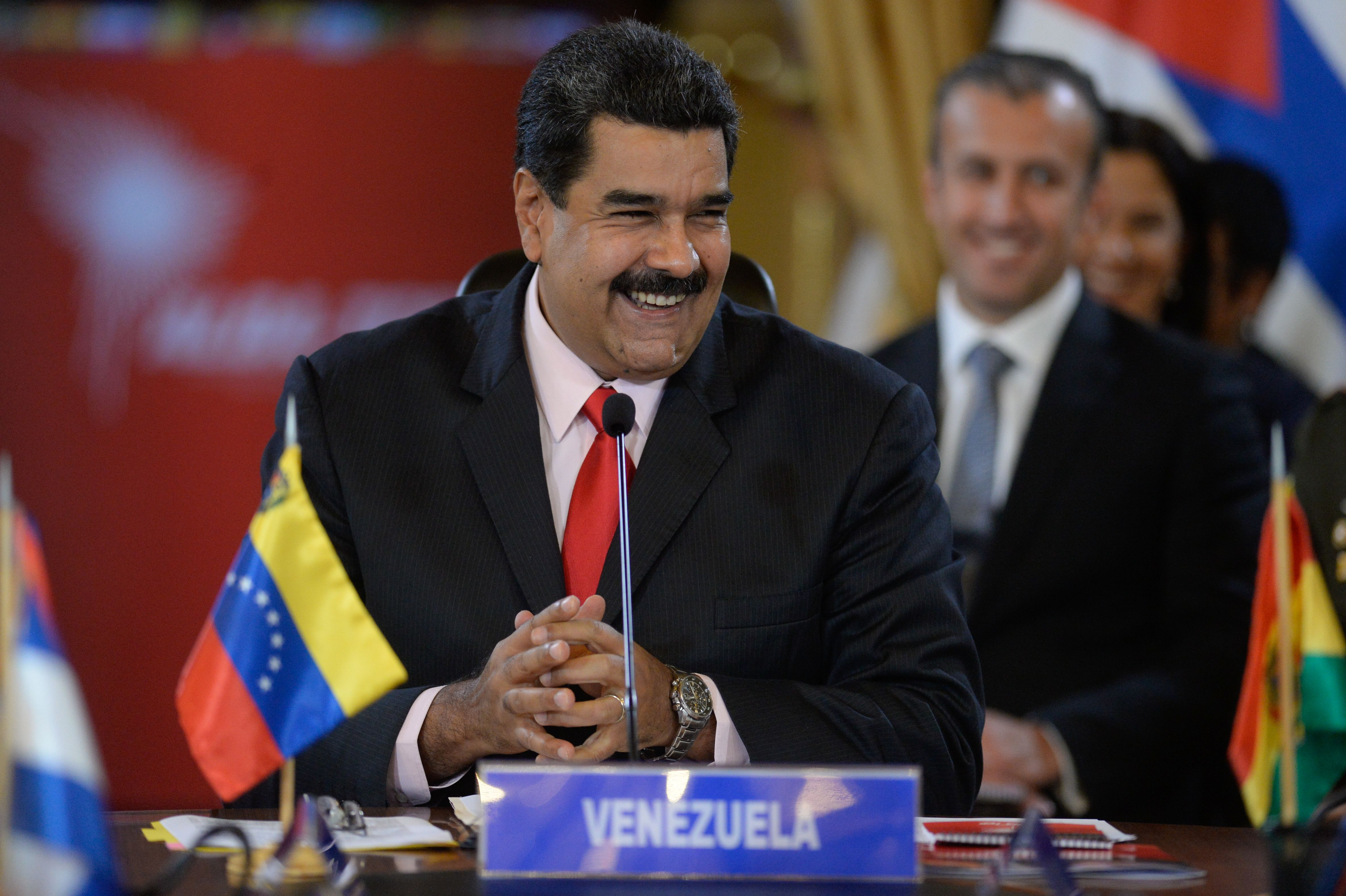 Venezuelan President Nicolas Maduro smiles while giving a speech at the Miraflores presidential palace in Caracas on March 5, 2017.