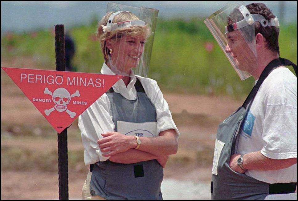 Britain's Princess Diana, is accompanied by a mine-clearing expert of the Halo Trust on 15 January 1997 in Huambo, Angola.