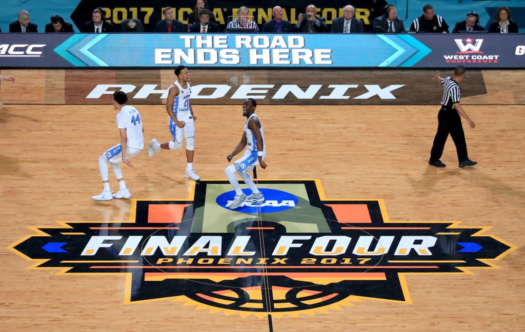 GLENDALE, AZ - APRIL 03: Justin Jackson #44, Nate Britt #0 and Theo Pinson #1 of the North Carolina Tar Heels celebrate after defeating the Gonzaga Bulldogs during the 2017 NCAA Men's Final Four National Championship game at University of Phoenix Stadium on April 3, 2017 in Glendale, Arizona. The Tar Heels defeated the Bulldogs 71-65. (Photo by Christian Petersen/Getty Images)