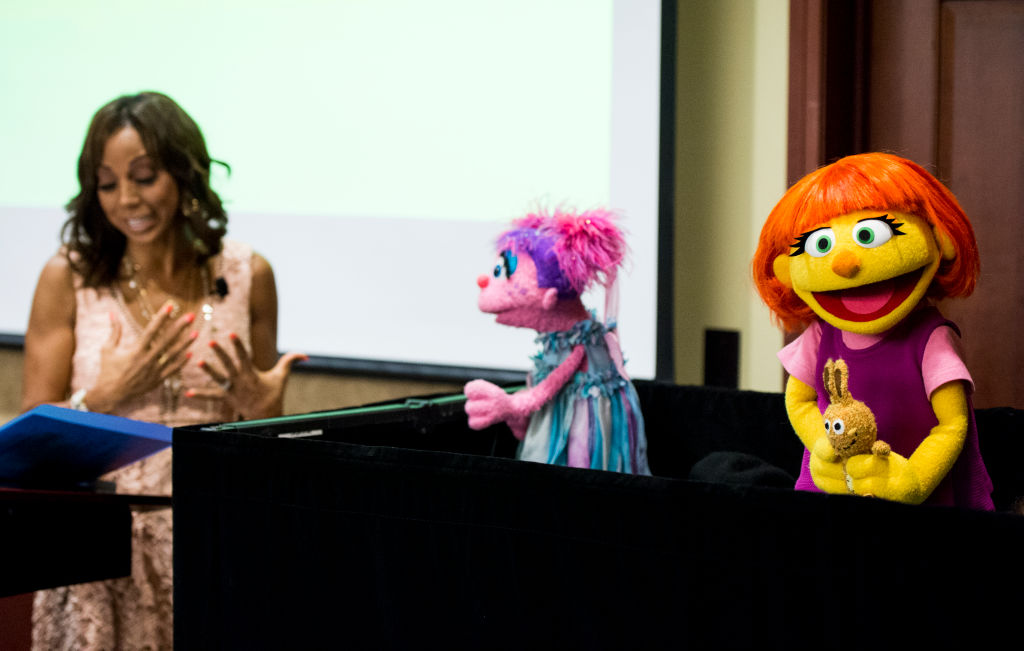 UNITED STATES - APRIL 4: From left, actress Holly Robinson Peete, and Sesame Street character Abby Cadabby introduce the newest Sesame Street Muppet Julia, a Muppet with autism, during a presentation in the Capitol Visitor Center on Tuesday, April 4, 2017. (Photo By Bill Clark/CQ Roll Call)