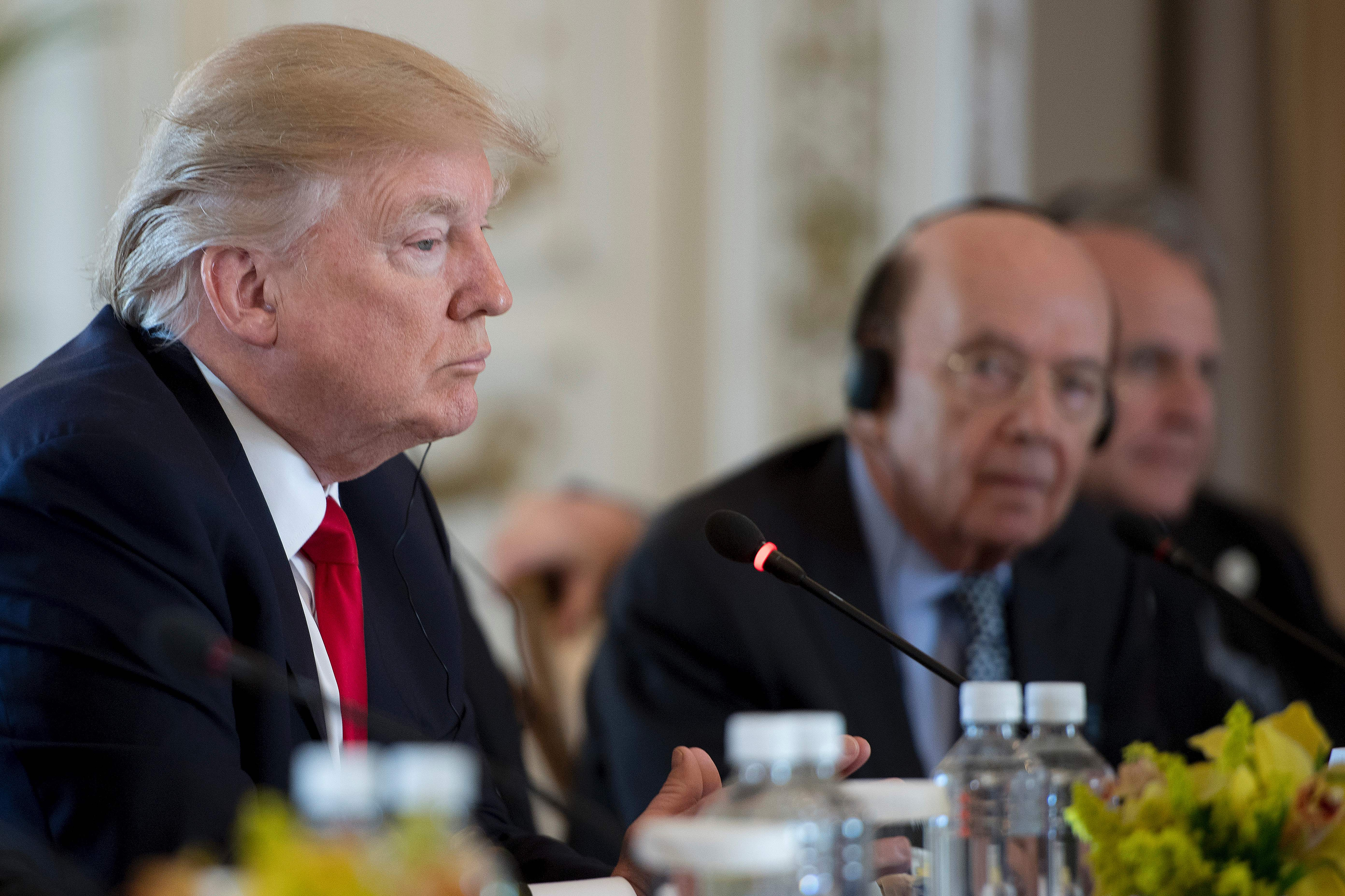 U.S. President Donald Trump listens during an expanded bilateral meeting with Chinese President Xi Jinping, not in the picture, at the Mar-a-Lago estate in West Palm Beach, Fla., on April 7, 2017