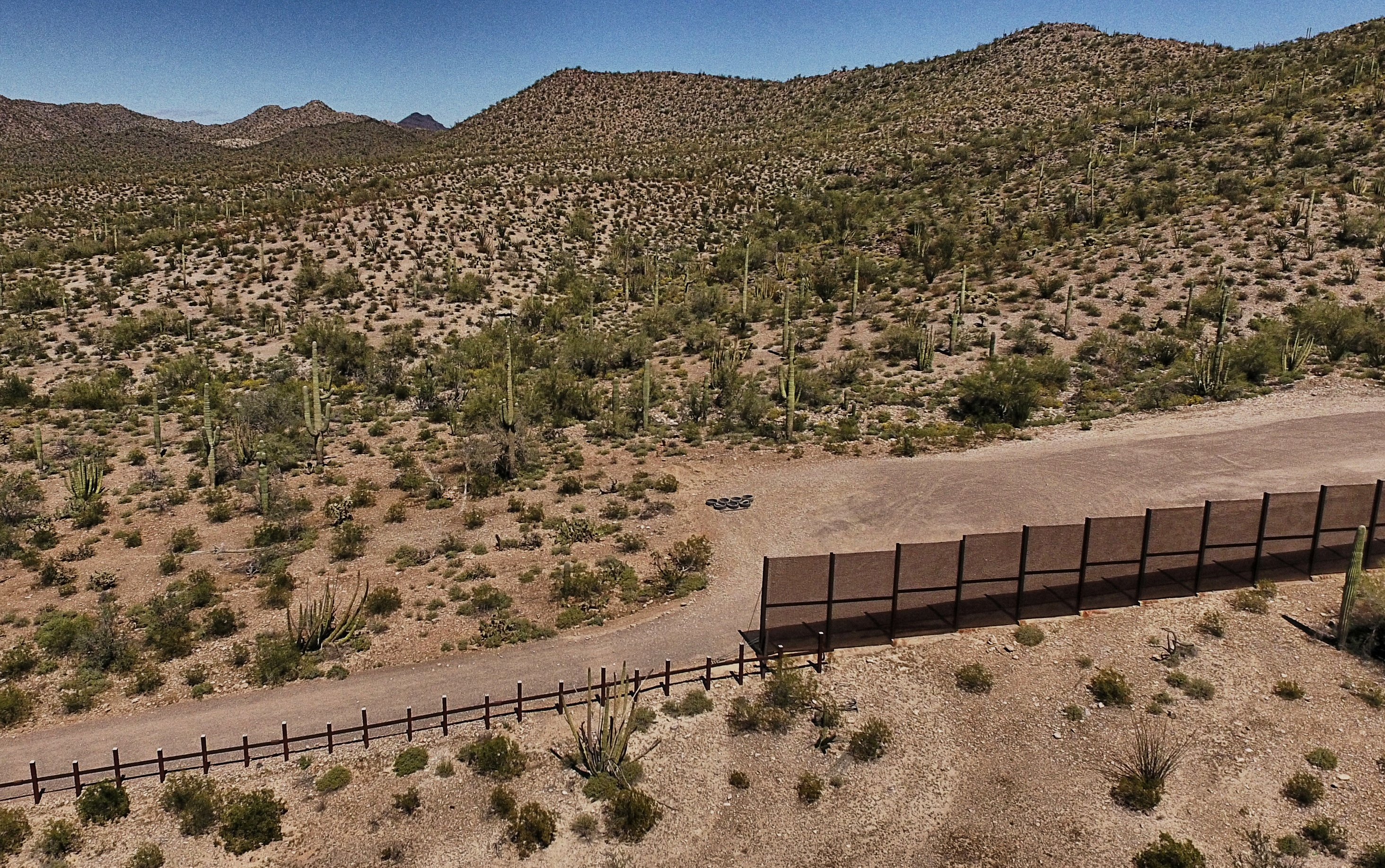 View of the metal fence along the border in Sonoyta, Sonora state, northern Mexico, between the Altar desert in Mexico and the Arizona desert in the United States, on March 27, 2017. PEDRO PARDO—AFP/Getty Images