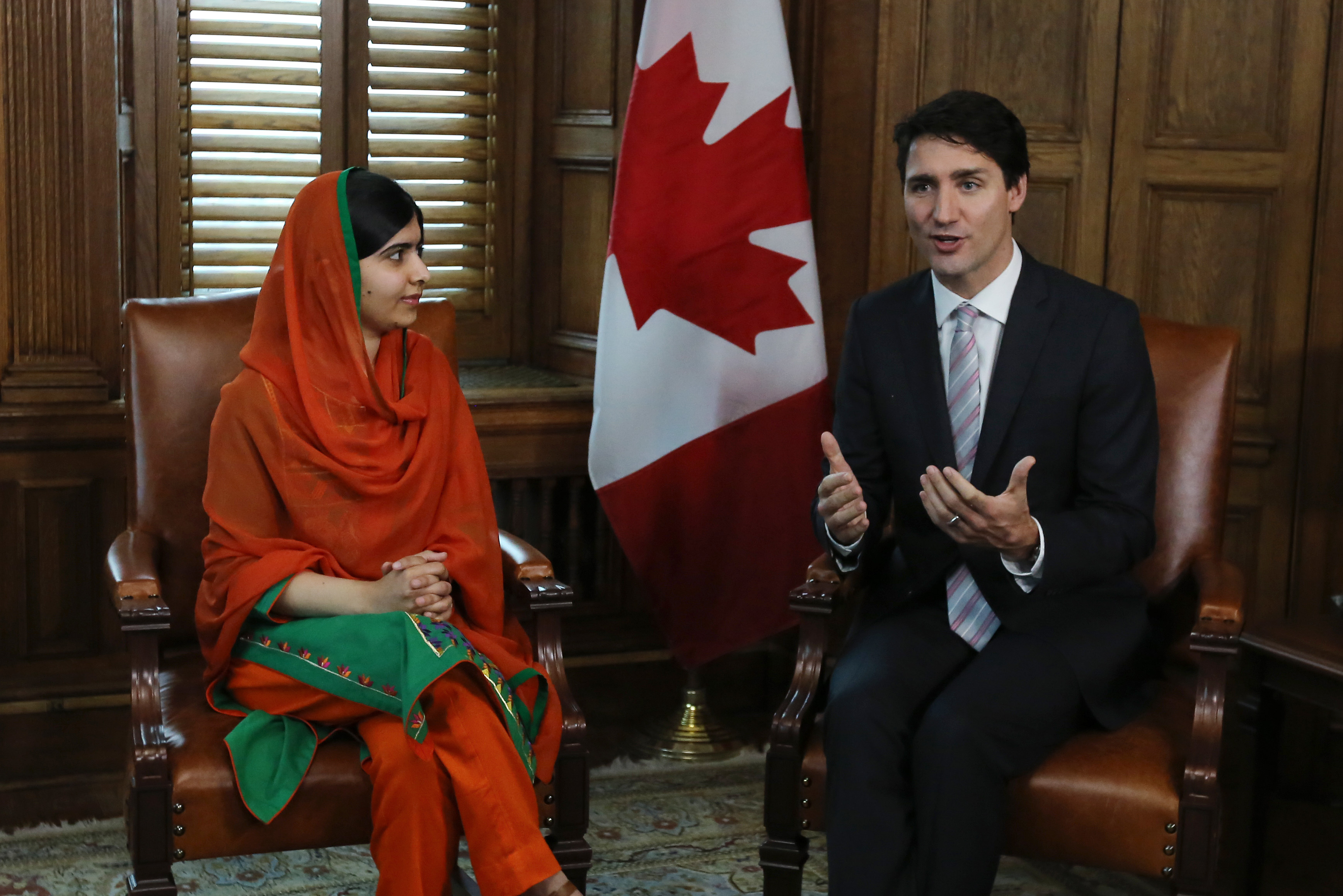 Malala Yousafzai speaks with Canadian Prime Minister Justin Trudeau in Trudeau's office on Parliament Hill in Ottawa, Ontario, April 12, 2017.
