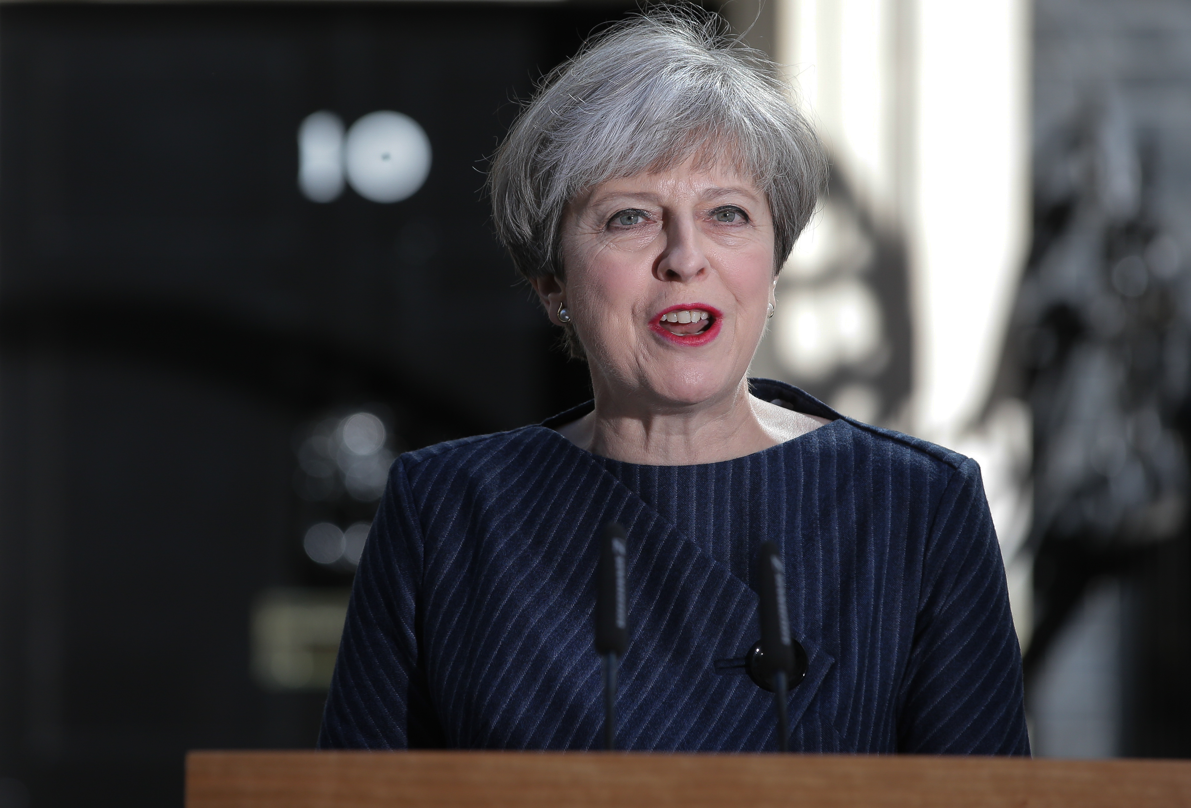 British Prime Minister Theresa May outside 10 Downing Street in central London on April 18, 2017.