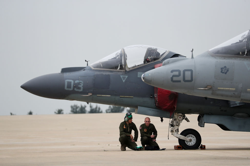 U.S. Air Force soldiers squat beneath U.S. ground-attack aircraft at a U.S. air base in Gunsan, South Korea, on April 20, 2017