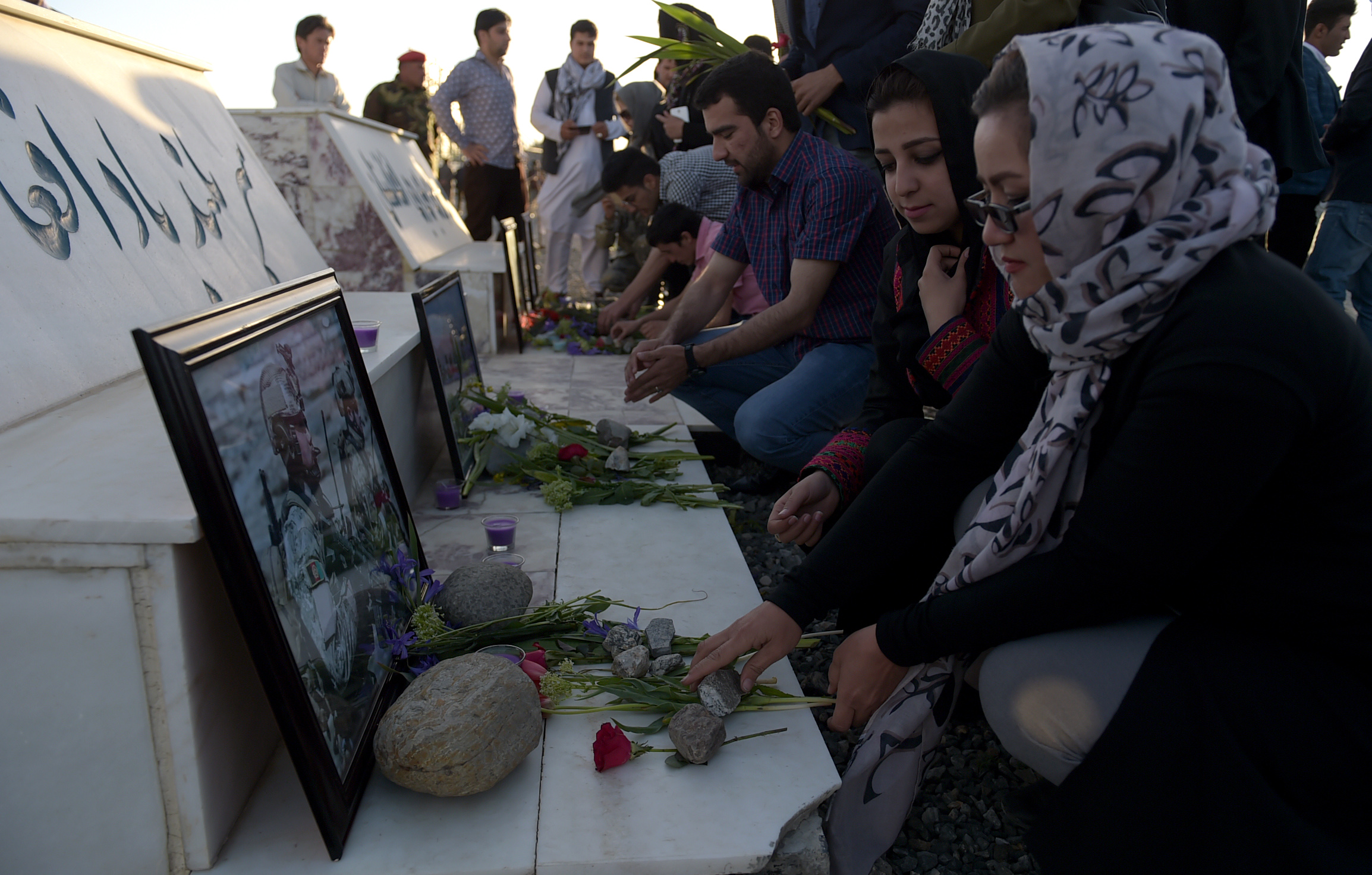 Afghans pay tribute to the victims of a Taliban attack on an army base on the Wazir Akbar Khan hilltop in Kabul on April 23, 2017.