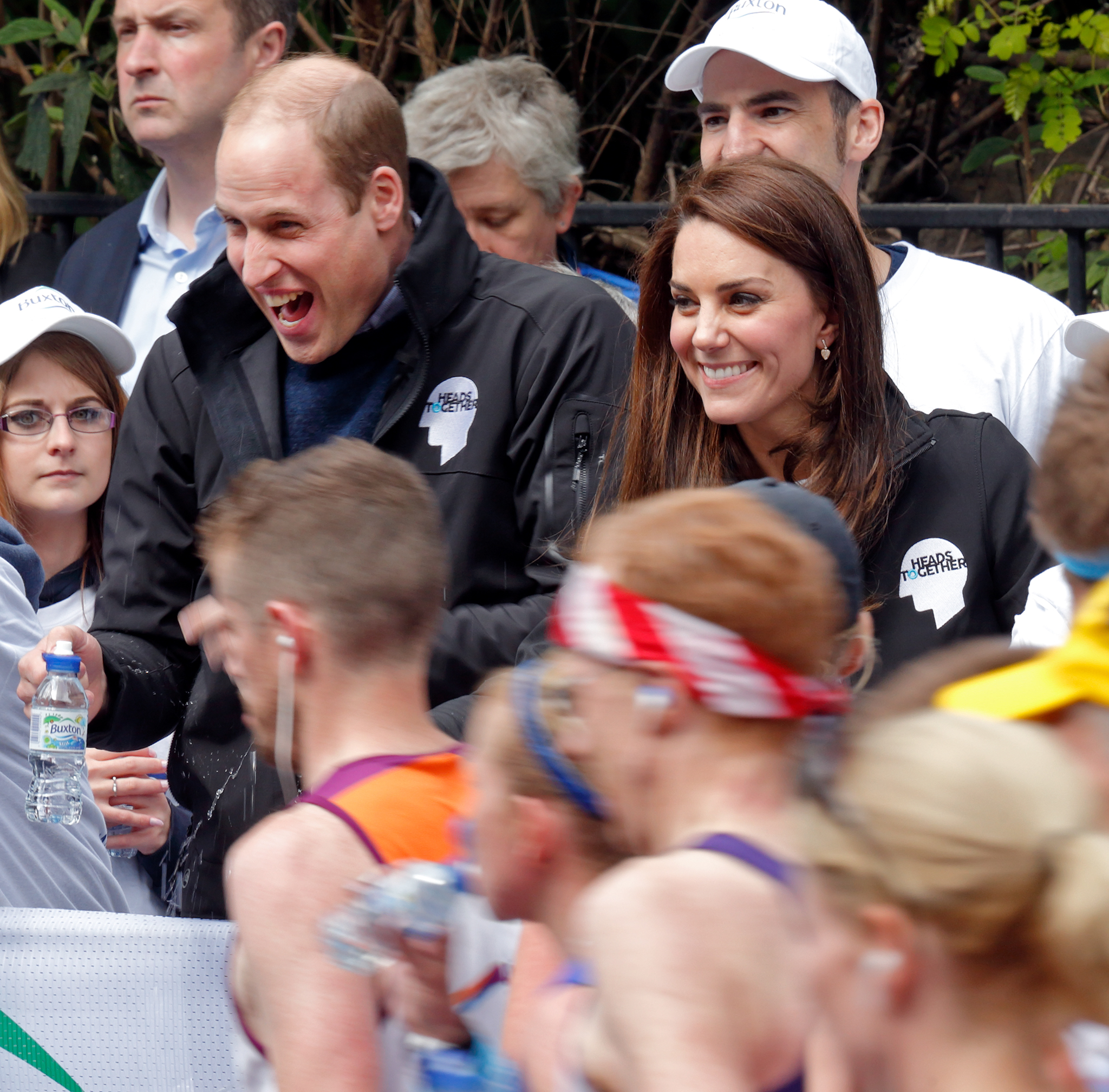 LONDON, UNITED KINGDOM - APRIL 23: (EMBARGOED FOR PUBLICATION IN UK NEWSPAPERS UNTIL 48 HOURS AFTER CREATE DATE AND TIME) Prince William, Duke of Cambridge is squirted with water as he & Catherine, Duchess of Cambridge hand out water to runners taking part in the 2017 Virgin Money London Marathon on April 23, 2017 in London, England. The Heads Together mental heath campaign, spearheaded by The Duke & Duchess of Cambridge and Prince Harry, is the marathon's 2017 Charity of the Year. (Photo by Max Mumby/Indigo/Getty Images)
