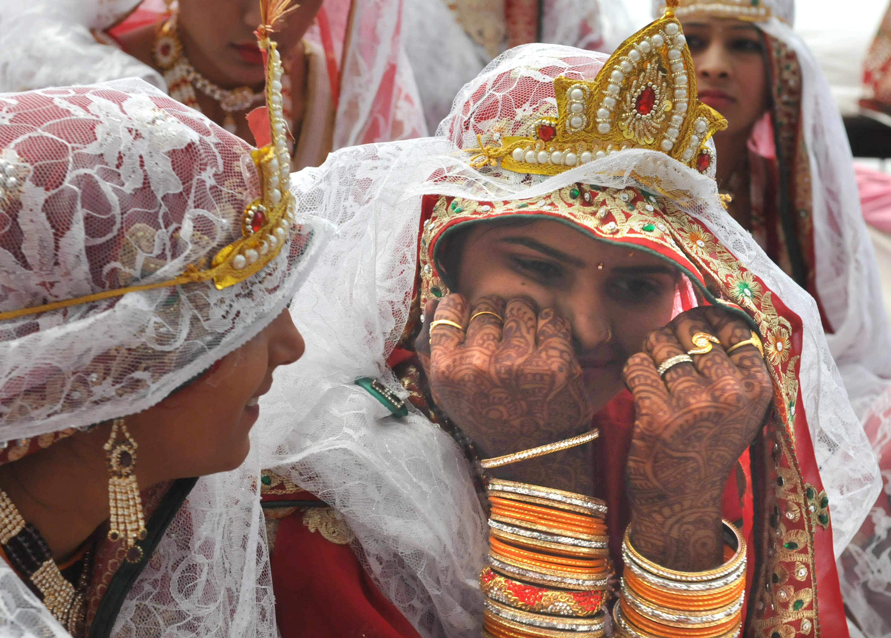 Brides share a light moment during mass marraige ceremony in Bhopal of Madhya Pradesh, India on April 29, 2017.
