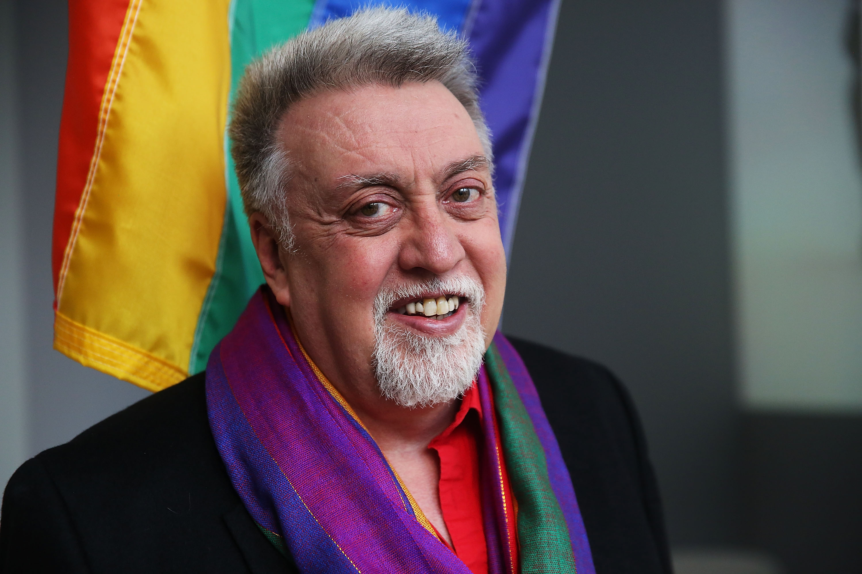 NEW YORK, NY - JANUARY 07:  Rainbow Flag Creator Gilbert Baker poses at the Museum of Modern Art (MoMA) on January 7, 2016 in New York City. MoMa announced in June 2015 its acquisition of the iconic Rainbow Flag into the design collection. Baker, an openly gay artist and civil rights activist, designed the Rainbow Flag in 1978. The flag has since become a prominent symbol to the gay community around the world.