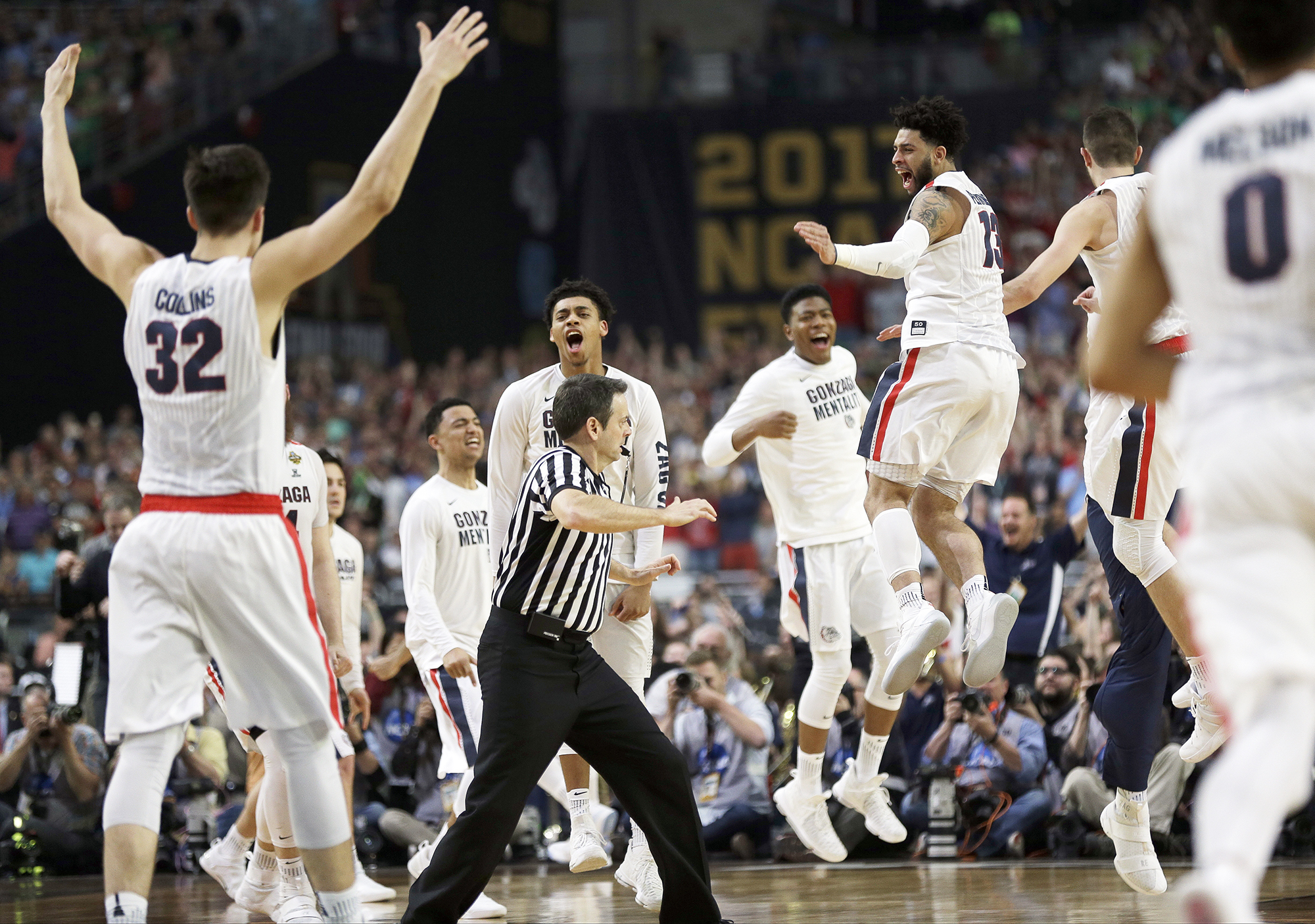 Gonzaga players celebrate after the semifinals of the Final Four NCAA college basketball tournament against South Carolina, on April 1, 2017, in Glendale, Ariz. Gonzaga won 77-73.
