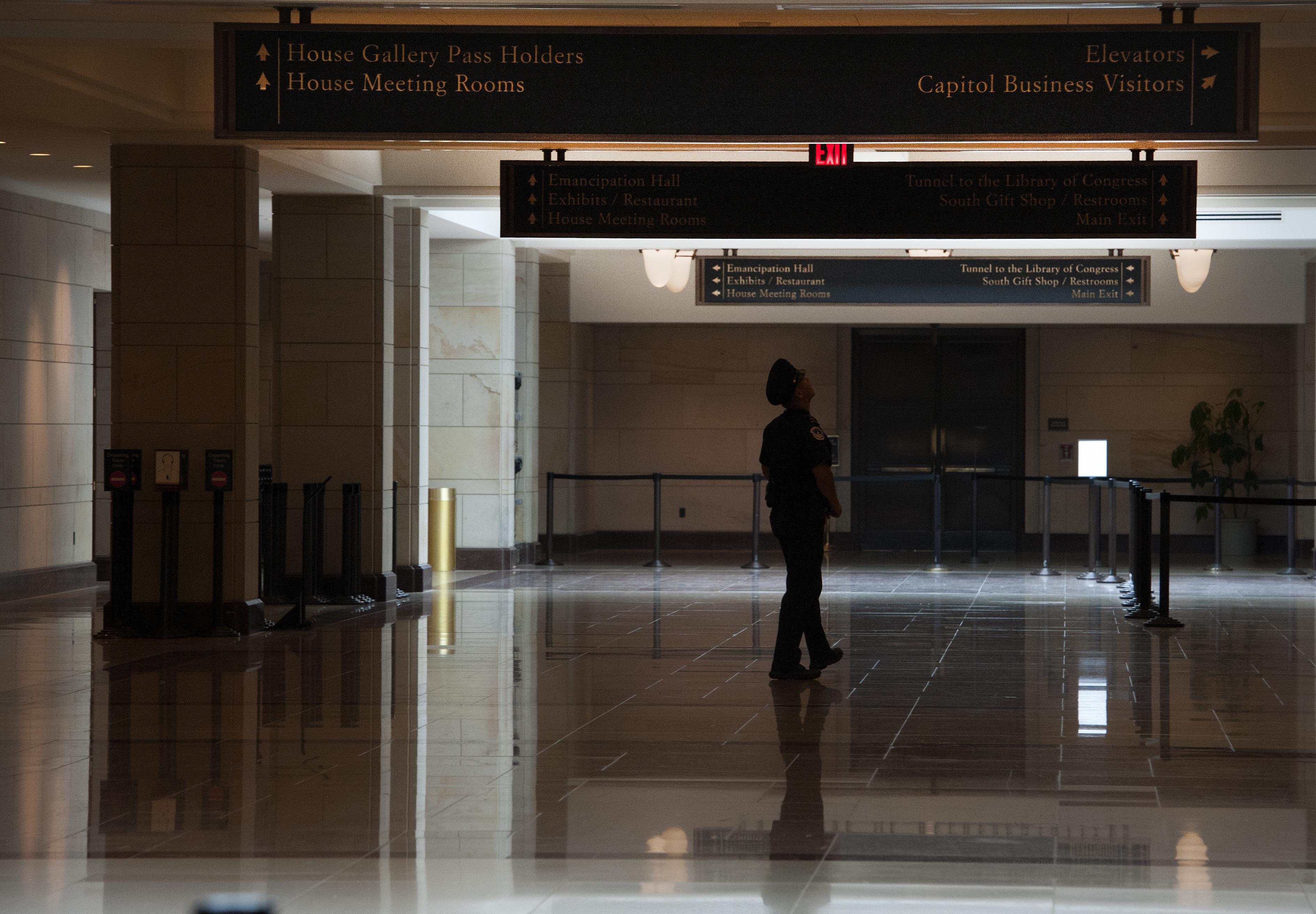 United States Capitol Hill policemen stand guard in an empty Capitol Visitors Center on  October 7, 2013, the 7th day of the government shutdown.