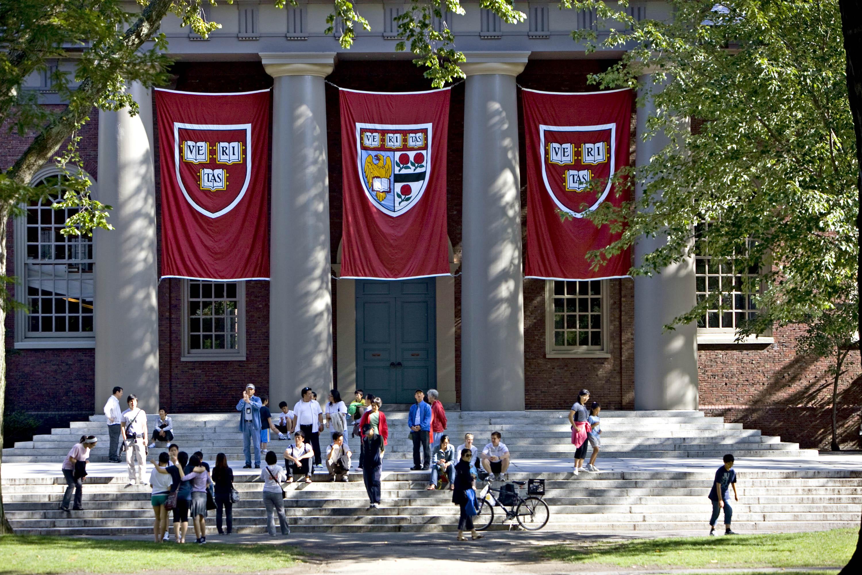 Harvard banners hang outside Memorial Church on the Harvard University campus in Cambridge, Massachusetts on Sept. 4, 2009.