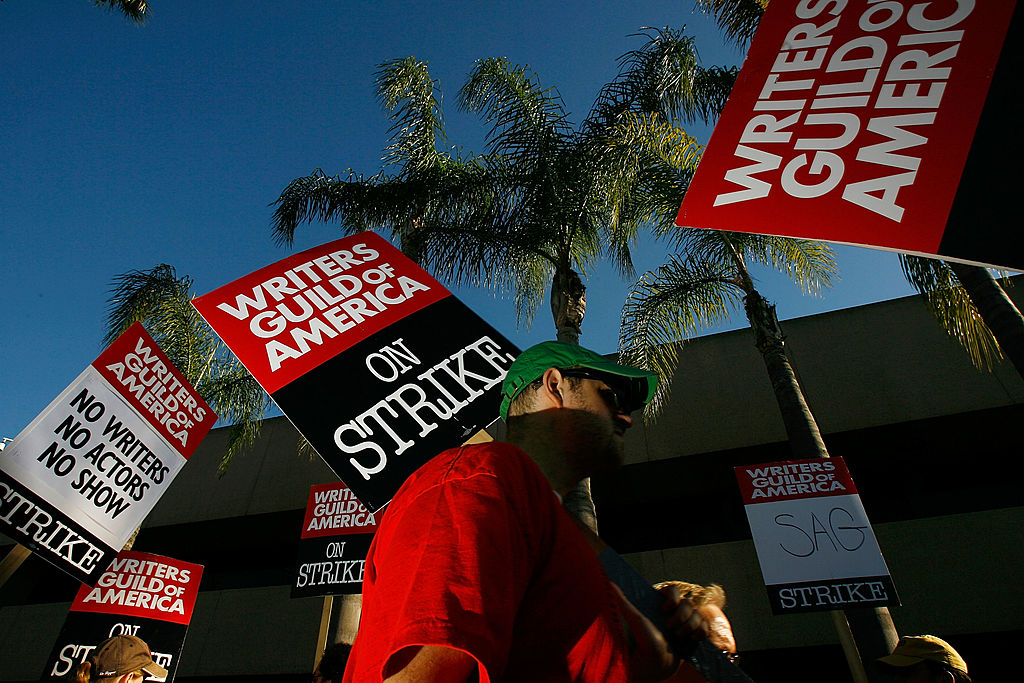 Writers Guild of America members and supporters picket in front of NBC studios as hope grows that a draft copy of a proposed deal with Hollywood studios being completed today could lead to an end to the three-month old Hollywood writers strike within days, on February 8, 2008 in Burbank, California.