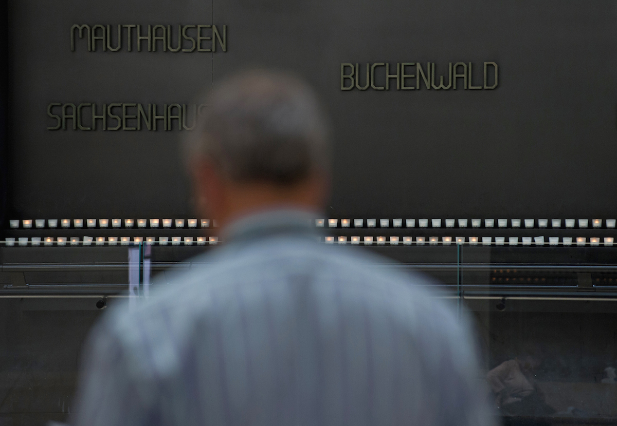 A man reads the names of vitims of the Holocaust in the Hall of Remebrance at the Holocaust Memorial Museum in Washington on Holocaust Remembrance Day in 2013.