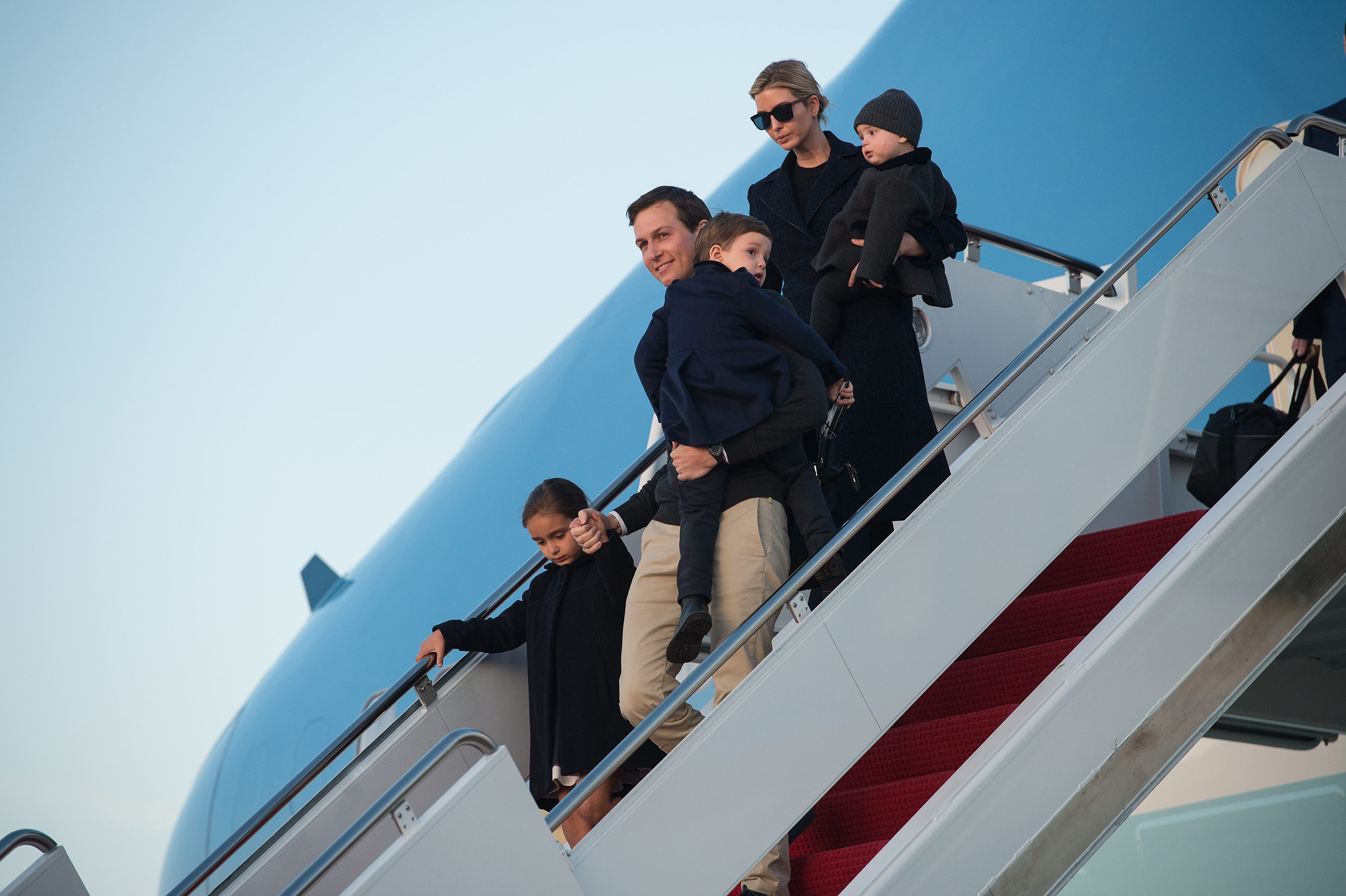 Jared Kushner and his wife Ivanka Trump step off Air Force One with their children Arabella (L), Joseph (C) and Theodore at Andrews Air Force Base in Maryland, on March 5, 2017.
