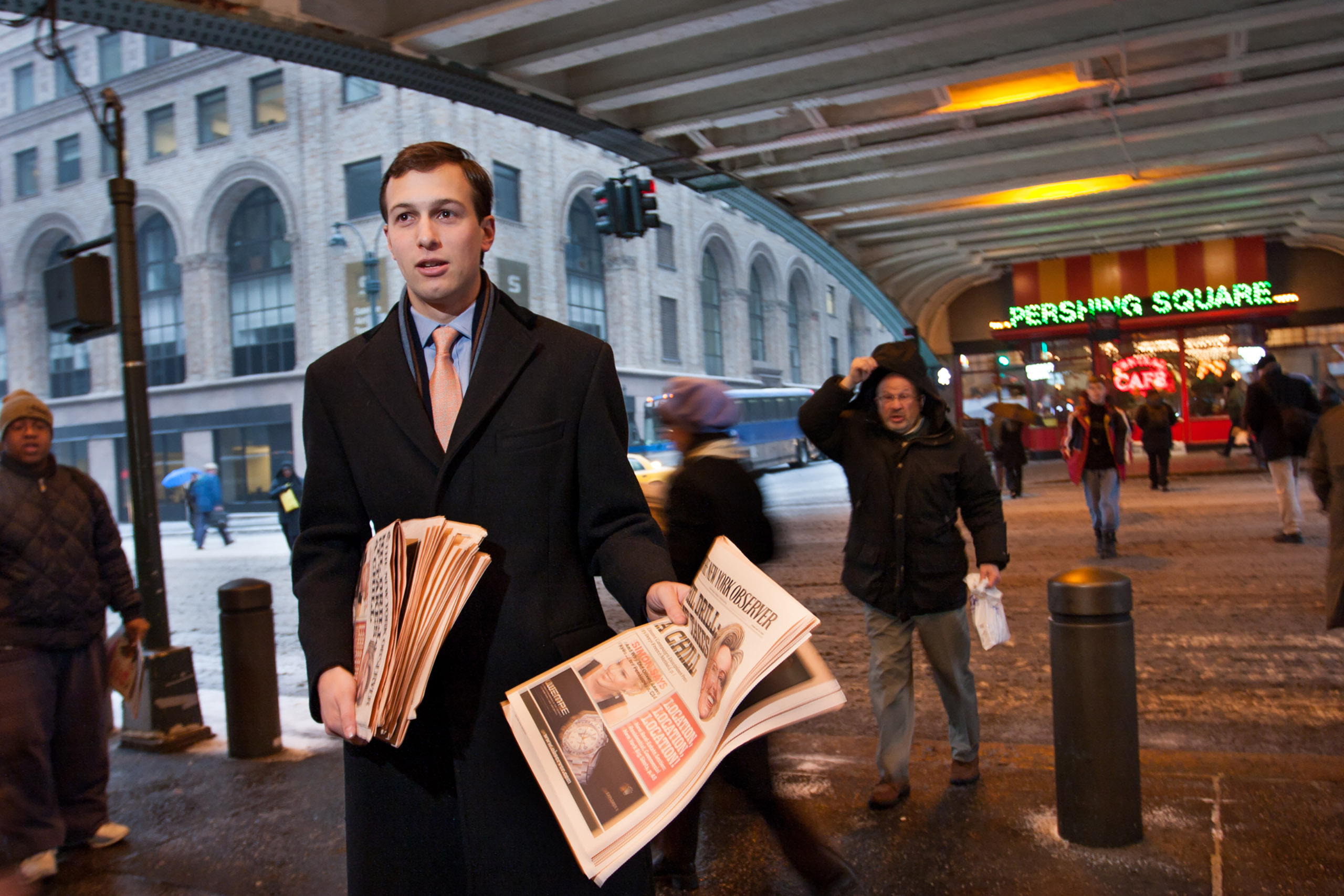 Jared Kushner handing out free copies of The New York Observer's first issue published under his new ownership, in front of Grand Central Station 42nd St., New York City, Feb. 14, 2007.