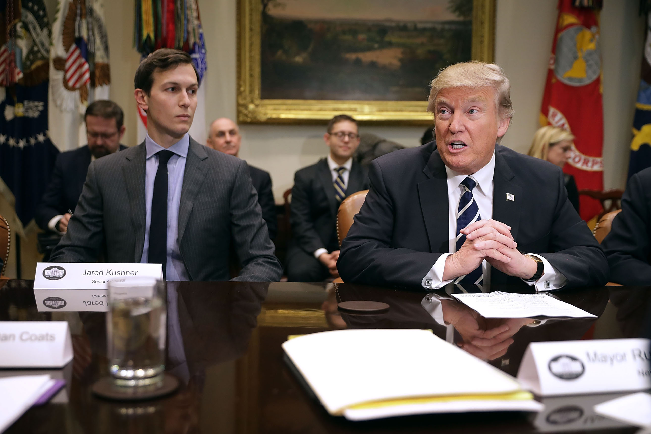 U.S. President Donald Trump (R) delivers remarks at the beginning of a meeting with his son-in-law and Senior Advisor Jared Kushner and government cyber security experts in the Roosevelt Room at the White House in Washington, D.C., Jan. 31, 2017.