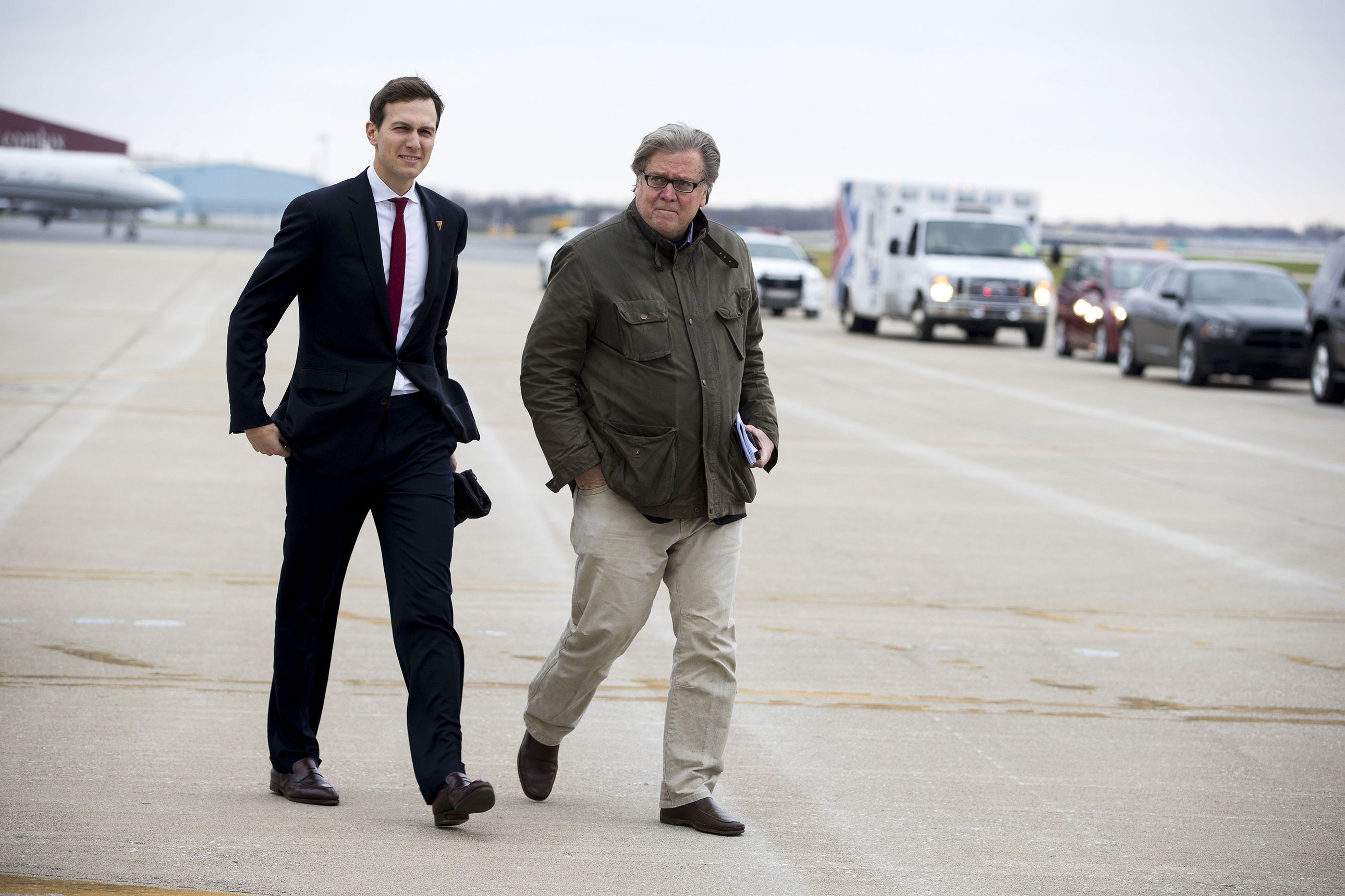 Steve Bannon, right, then a senior strategist for President-elect Donald Trump, and Jared Kushner, Trump's son-in-law, arrive in Indianapolis, for a rally, Dec. 1, 2016.