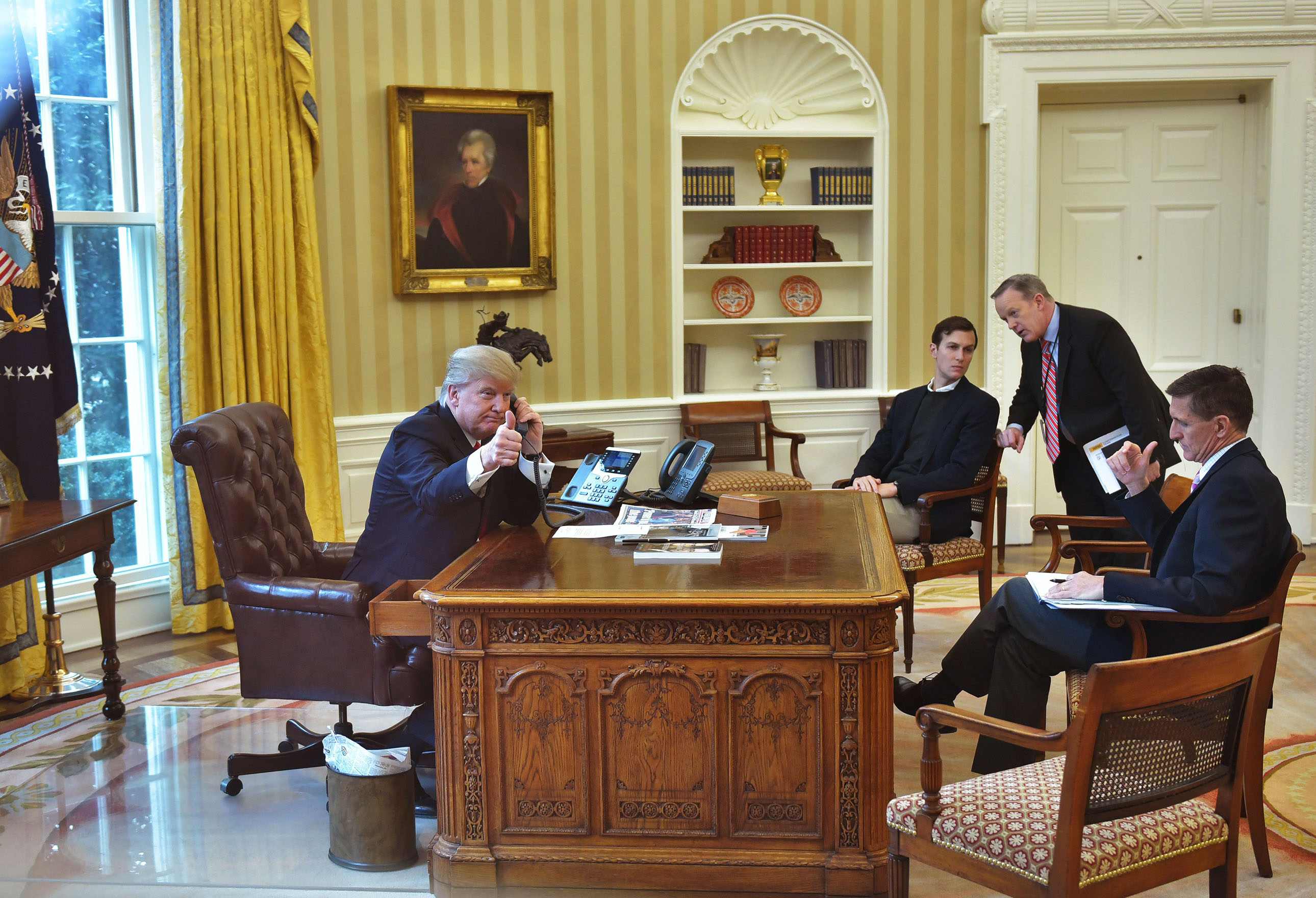Jared Kushner (2L), Press Secretary Sean Spicer (2R), and Security Advisor Michael Flynn (R), with President Trump,as he speaks on the phone to King Salman of Saudi Arabia in the Oval Office on Jan. 29, 2017.