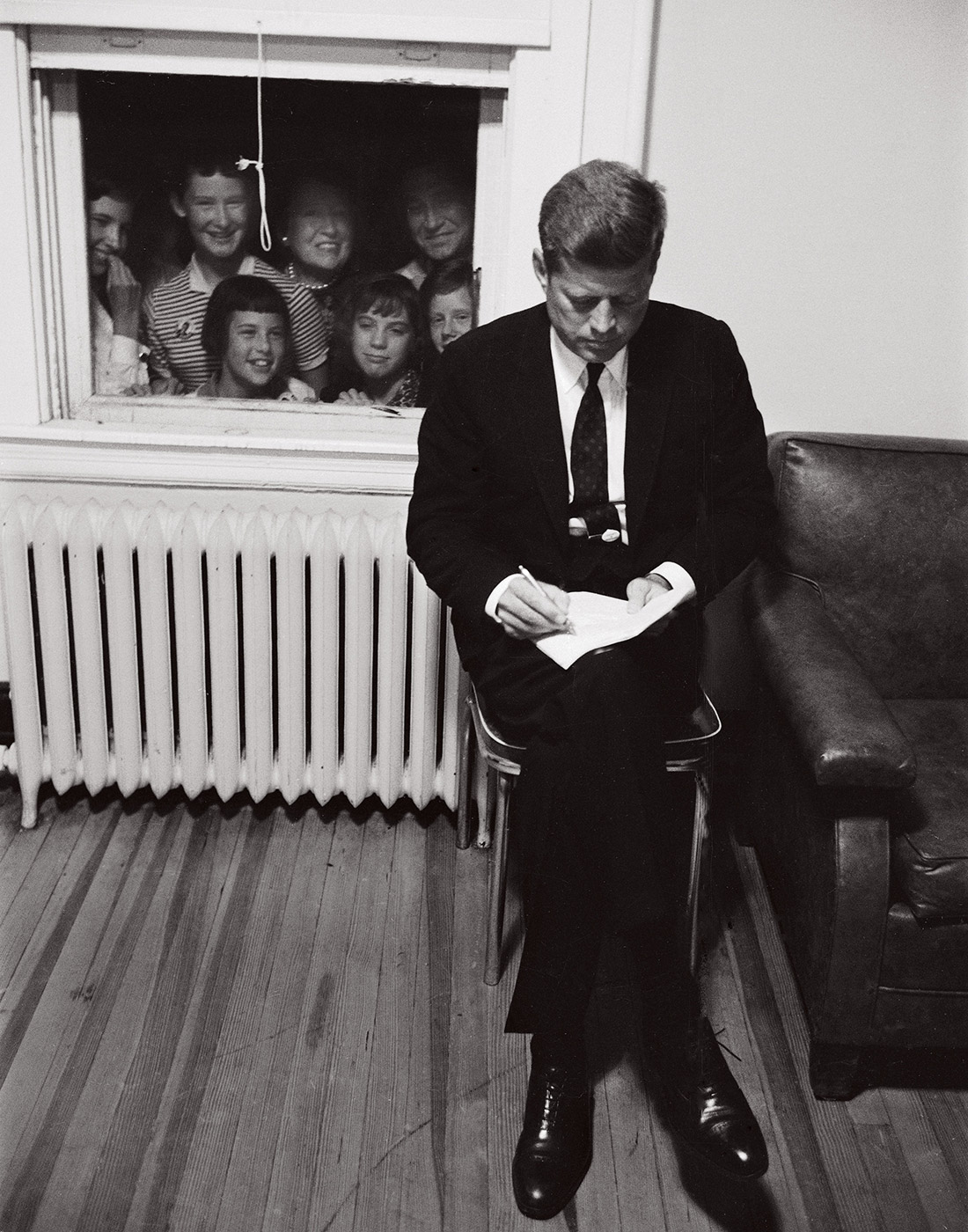 Kennedy preparing a speech, Baltimore, September 1960. © Paul Schutzer (Courtesy The LIFE Picture Collection/Getty Images)