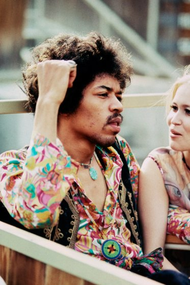 Jimi Hendrix sits next to Carmen Borrero in a Pool Box seat during afternoon sound check at the Hollywood Bowl, Sept. 14, 1968.