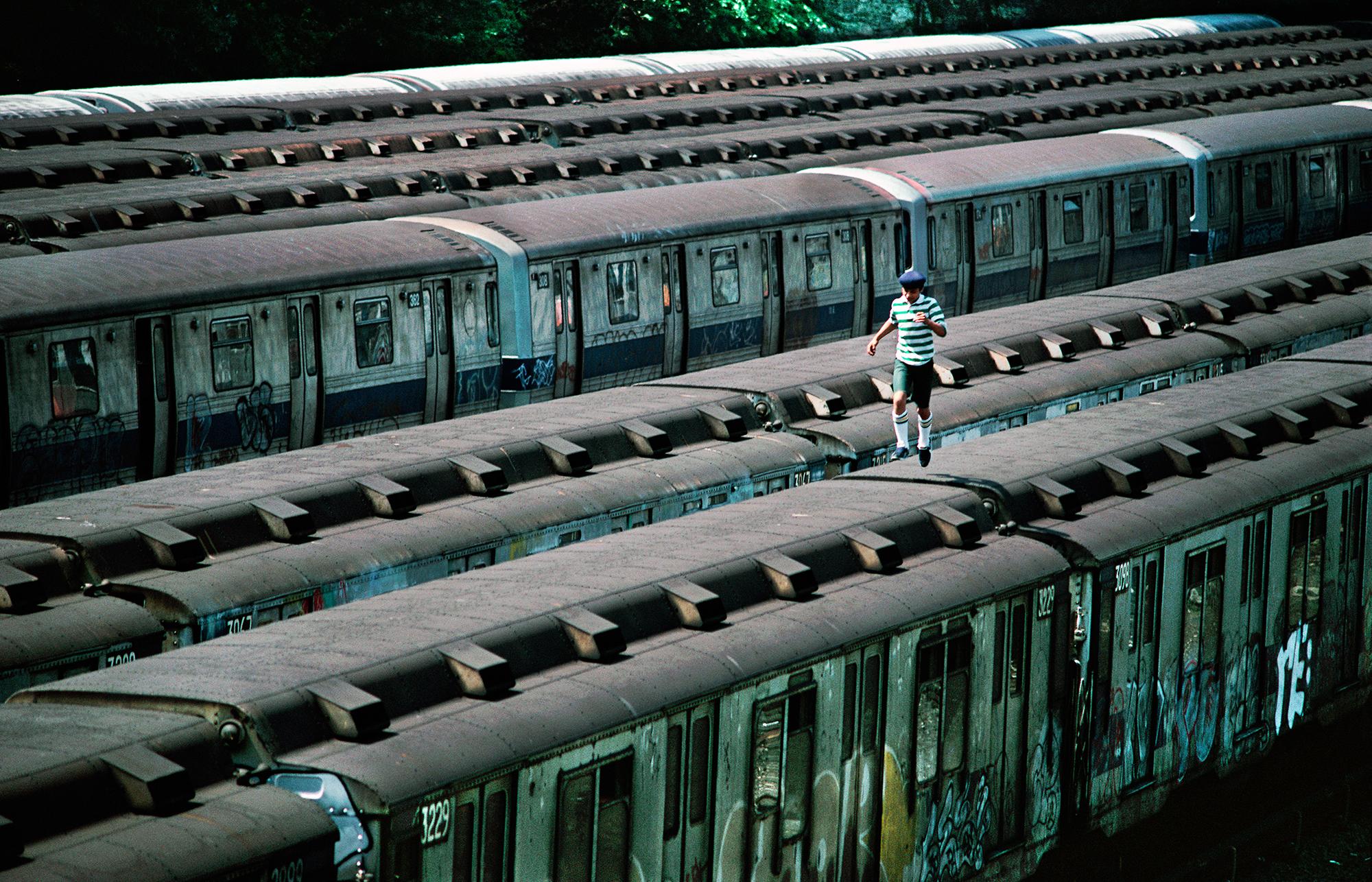 Boy Running on Top of Train, CC Yard, Bronx, NY, 1983