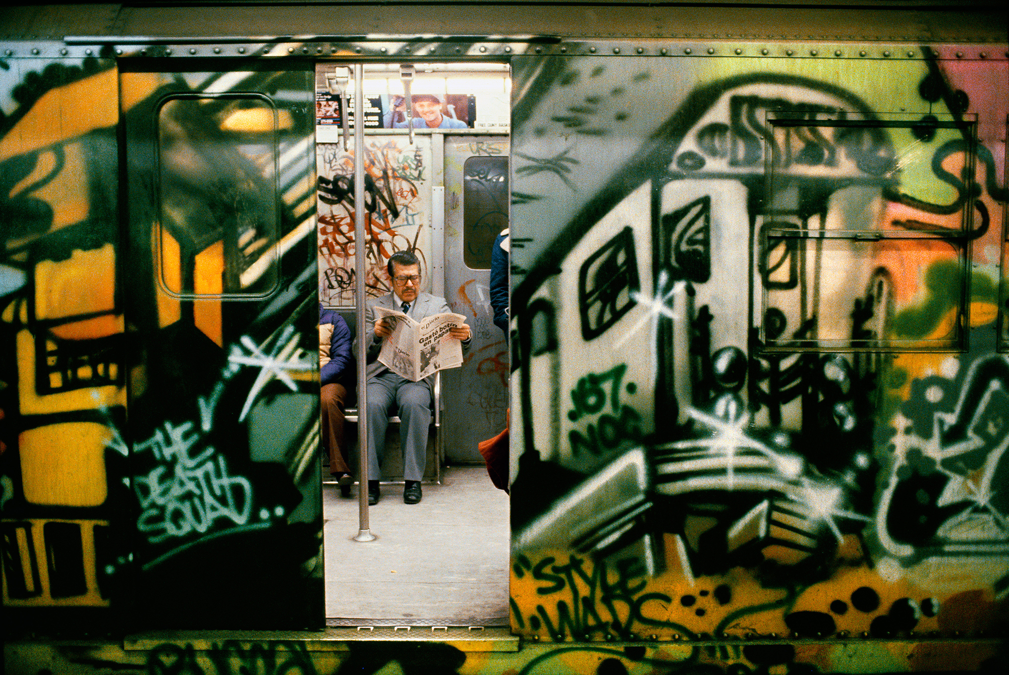 Style Wars Car by NOC 167 with Door Open, Man Reading Newspaper, 96th Street Station, New York, NY, 1981