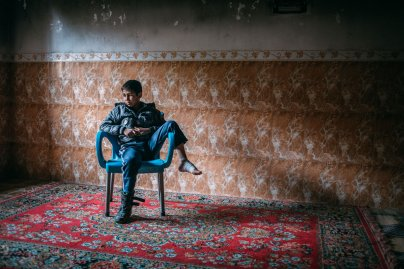 """Ali Bashar Ali, 8, lives with his family in his grandfather's house in the Mosul al-Jadida neighborhood of western Mosul, where Iraqi forces are battling Islamic State militants for control of the city. While fleeing their home, Ali was hit in the foot by a stray bullet. On April 1, 2017, he answered a few questions about his recent days in this war zone. His most recent meal? """"Tomato soup and rice. During the battle [the liberation of his neighborhood] we only ate a few meals in three days."""" How does he fall asleep at night? """"We don't sleep well. I sleep a little and then wake up, until morning."""" His favorite toy? """"A boat."""" What does he want to be when he grows up? """"A doctor."""""""