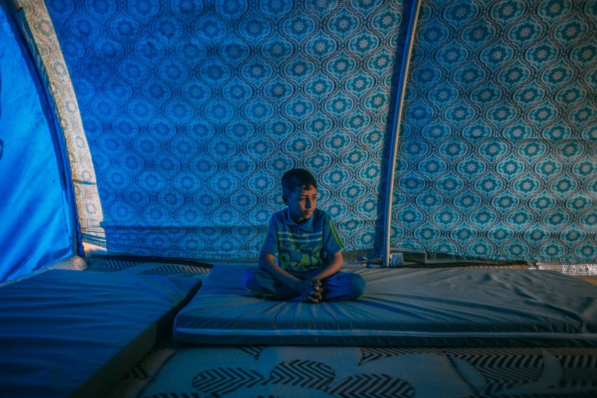 """Ayman Mohamed Ahmed lives in the Hamam al-Alil displacement camp south of Mosul. On April 6, 2017, he answered a few questions about his recent days in this war zone. His most recent meal? Rice and beans. What does he think about at night? """"I hope ISIS members do not come and blow themselves up in our house."""" His favorite toy? He doesn't have toys in the camp, but back at home it was a car. What does he want to be when he grows up? A doctor, because that's """"the best"""" and he wants to help people."""