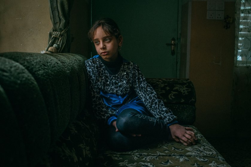 """Farah el-Kelo, nine years old, lives with her extended family of dozens of people in a large house in the neighborhood of Mosul al-Jadida. After fleeing the fighting between Iraqi forces and Islamic State militants, some of the family moved in together. On April 1, she answered a few questions about her recent days in this war zone. Her most recent meal? """"Yogurt, tahini and tea."""" How does she fall asleep at night? """"I sleep okay, but I used to sleep better before [the battle]."""" Her favorite toy? """"A kitchen with pots and pans."""" And what does she want to be when she's older? """"A doctor."""""""
