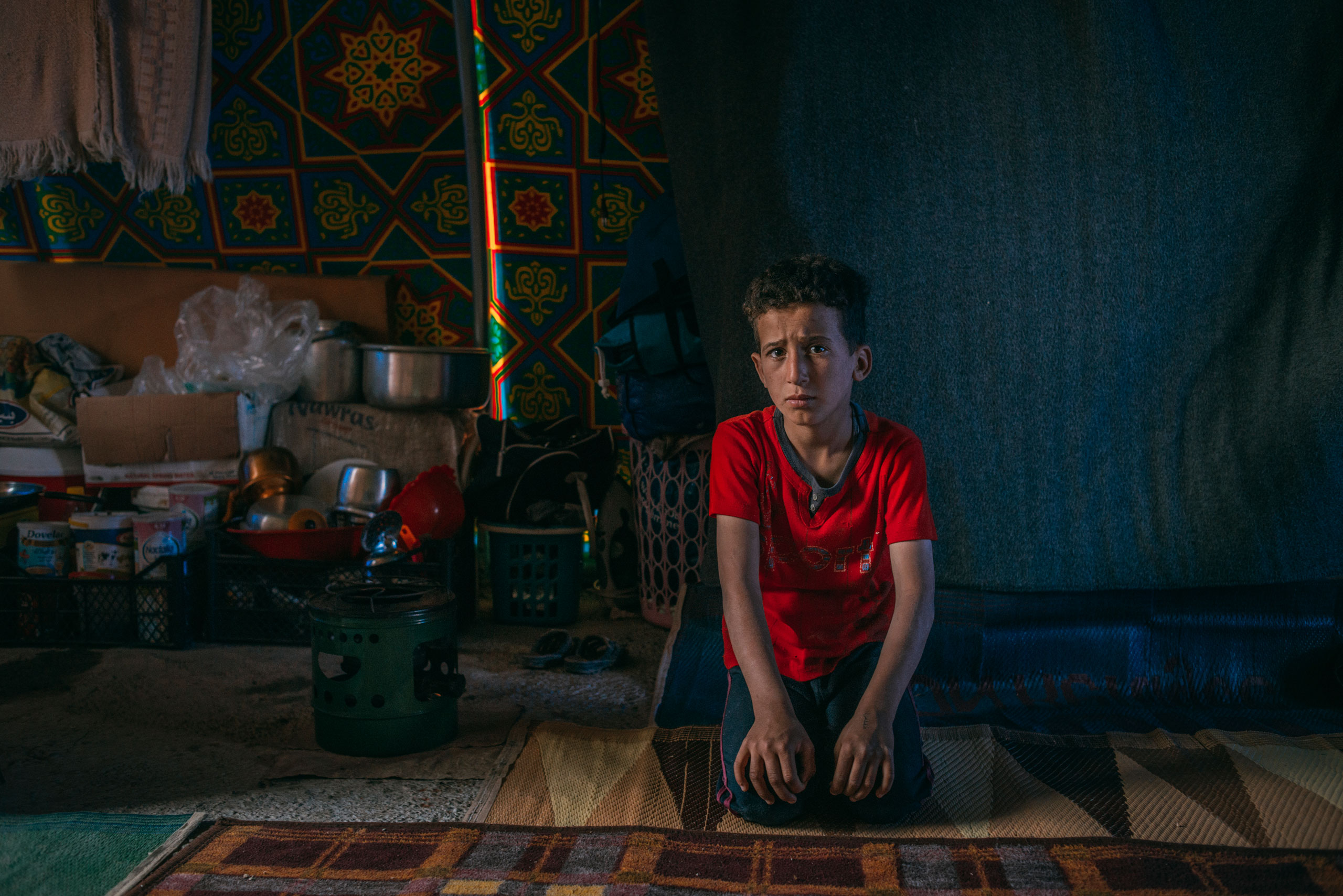 Hassan Falah Hamid, 10, lives in the Hamam al-Alil displacement camp south of Mosul. On April 6, 2017, he answered a few questions about his recent days in this war zone. His most recent meal? Fava beans. What does he think about at night? He was afraid of ISIS and the shelling. His favorite toy? He doesn't have toys in the camp, but back at home it was a bicycle. What does he want to be when he grows up? A teacher.