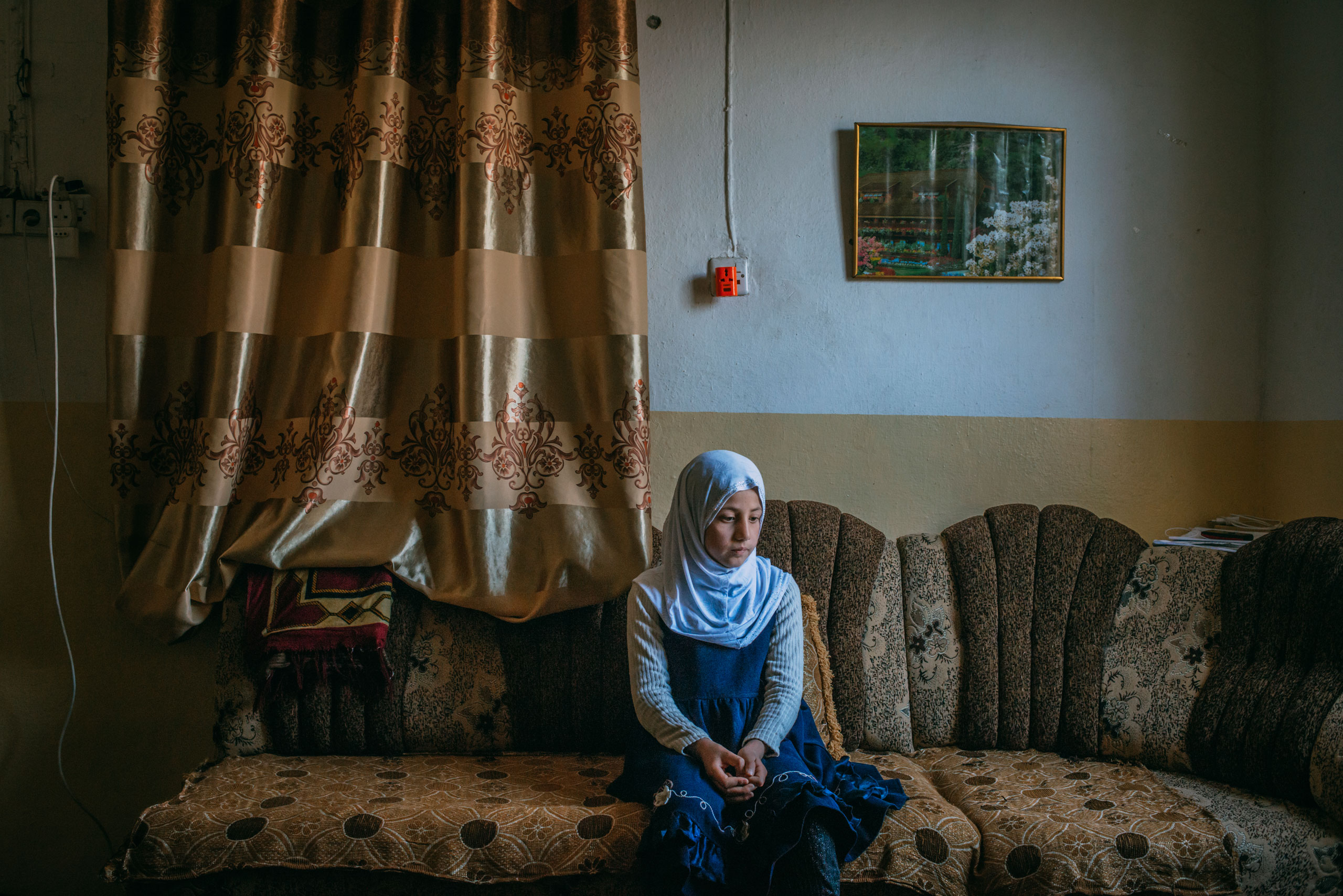 """Safiya Qais, 9, lives with her family in a section of eastern Mosul that was liberated from ISIS in January. During the offensive, her house was overrun with Islamic State militants. Her family was forced to flee for several weeks, living in an empty house that was further from the clashes. The home's exterior is riddled with bullet holes. On April 2, 2017, she answered a few questions about her recent days in this war zone. Her most recent meal? Eggs. How does she fall asleep at night? She sleeps well now; she just closes her eyes and tries to sleep. Before, """"I was afraid of the planes bombing."""" What does she want to be when she grows up? A teacher."""