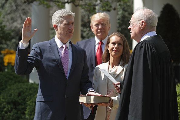 U.S. Supreme Court Associate Justice Anthony Kennedy (R) administers the judicial oath to Judge Neil Gorsuch as his wife Marie Louise Gorsuch holds a bible and President Donald Trump looks on during a ceremony in the Rose Garden at the White House April 10, 2017 in Washington, DC.