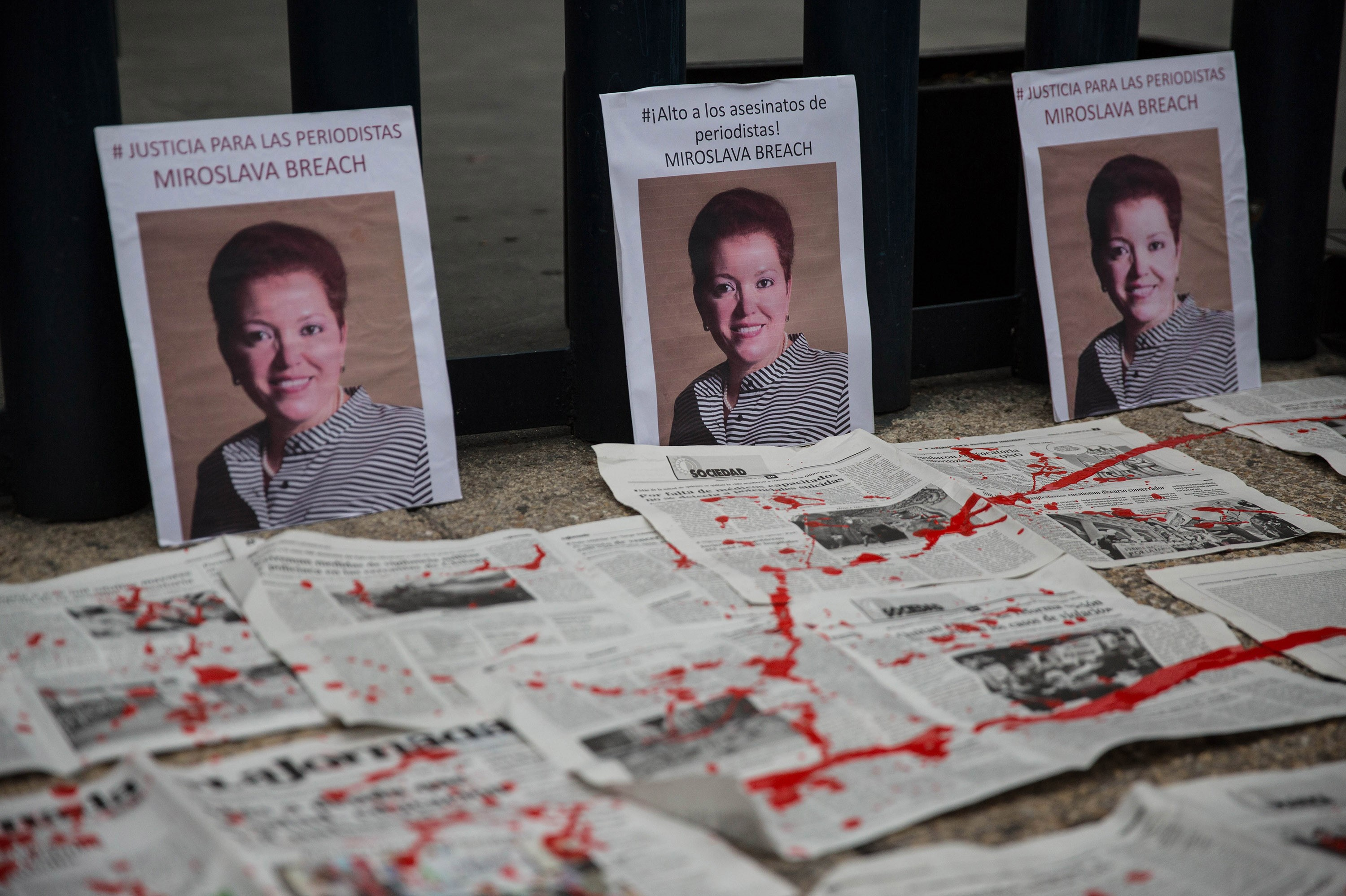 Portraits of Miroslava Breach are seen during a protest against the recent murder of the correspondent journalist for  La Jornada  newspaper, in Mexico City, Mexico on March 25, 2017. The correspondent who was killed in Chihuahua is third Mexican journalist killed in the month of March.