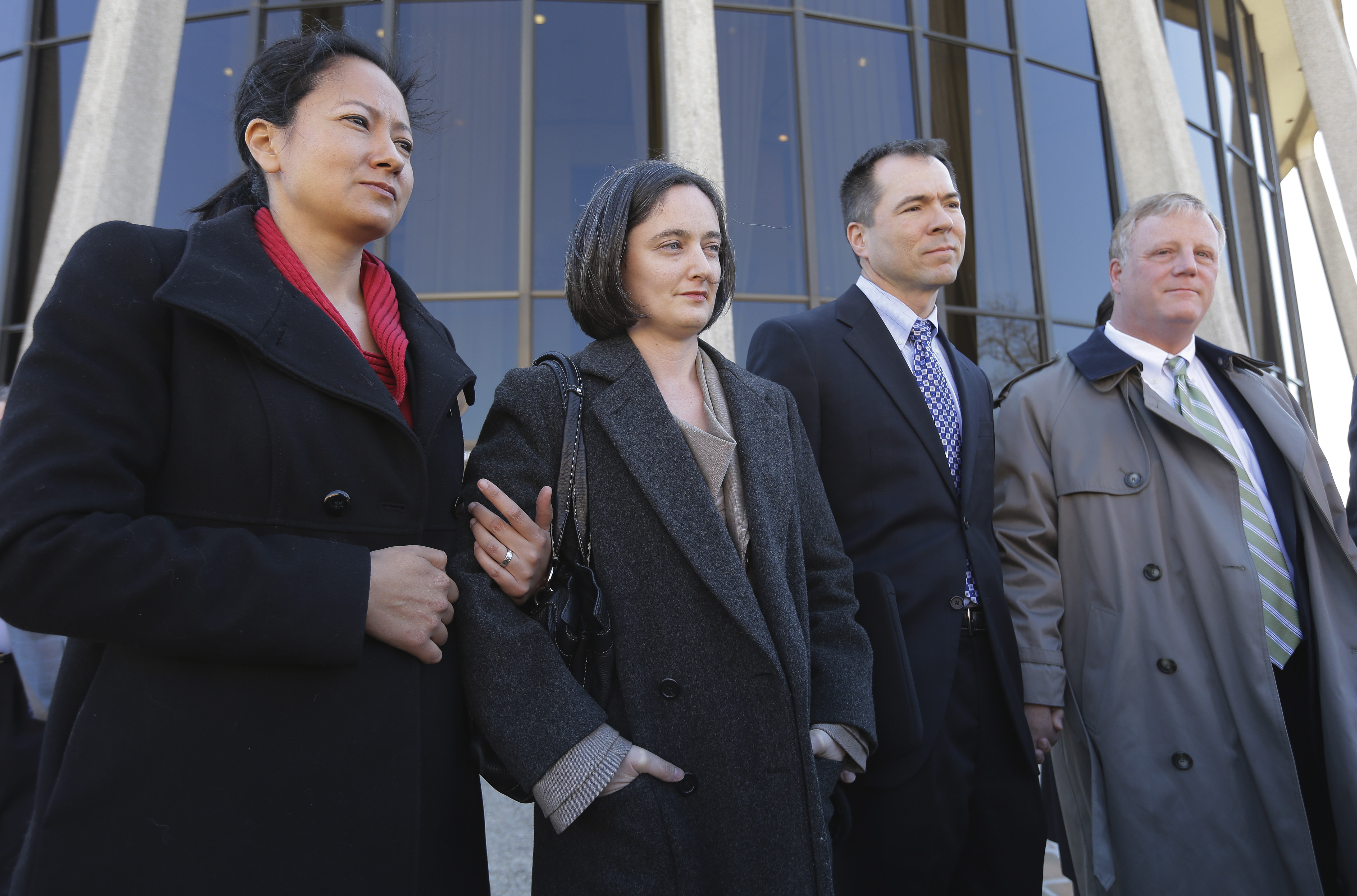 Same-sex couples Cleopatra De Leon, left, and partner, Nicole Dimetman, second from left, and Victor Holmes and partner Mark Phariss, right, talk with the media after as they leave the U.S. Federal Courthouse, in San Antonio on  Feb. 12, 2014.