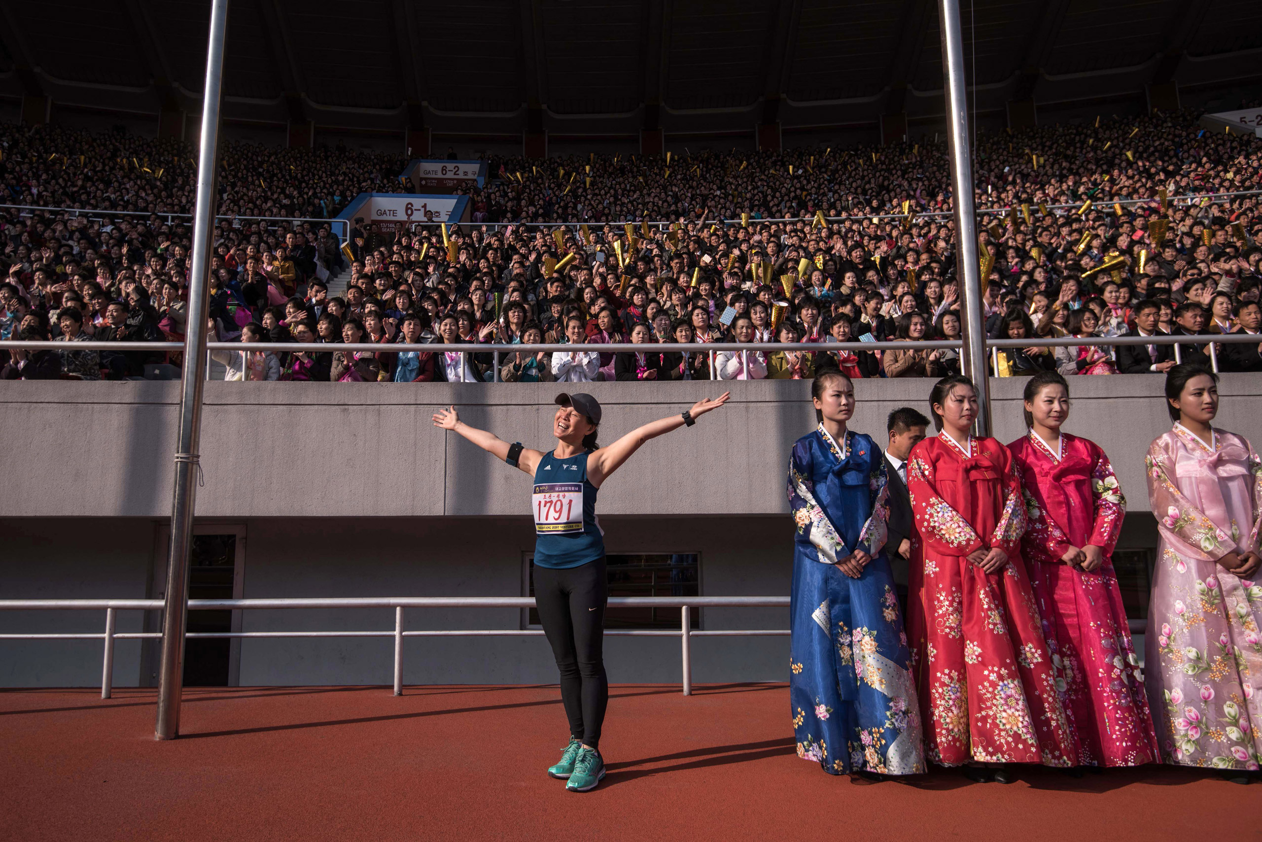 A foreign competitor poses for a photo prior to the start of the Pyongyang Marathon at Kim Il-Sung stadium in Pyongyang on April 9, 2017. Hundreds of foreigners lined up in Pyongyang's Kim Il-Sung Stadium on April 9 for the city's annual marathon, the highlight of the tourism calendar in isolated North Korea.