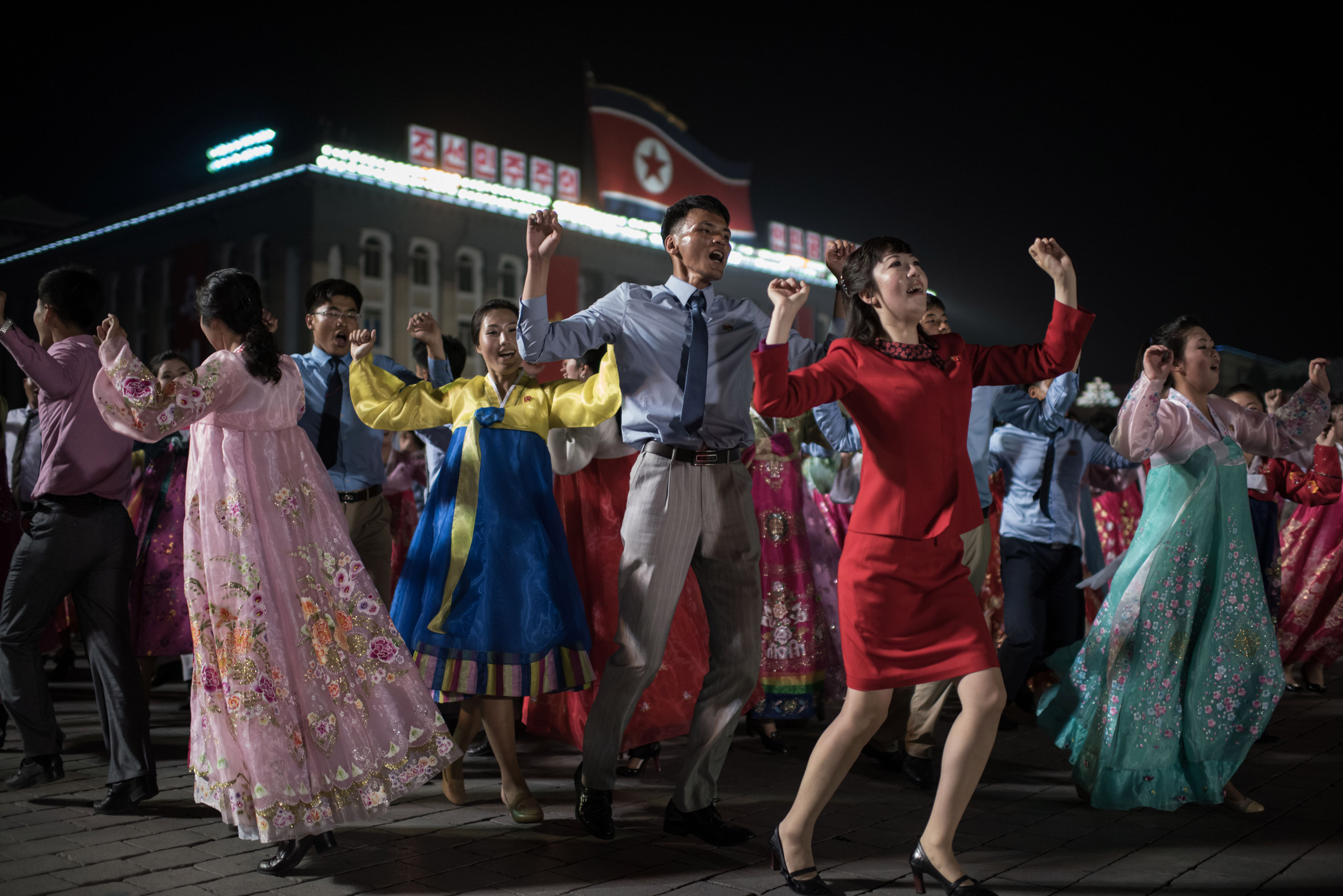Participants perform in a mass dance event on Kim Il-Sung square marking the 105th anniversary of the birth of late North Korean leader Kim Il-Sung, in Pyongyang on April 15, 2017.