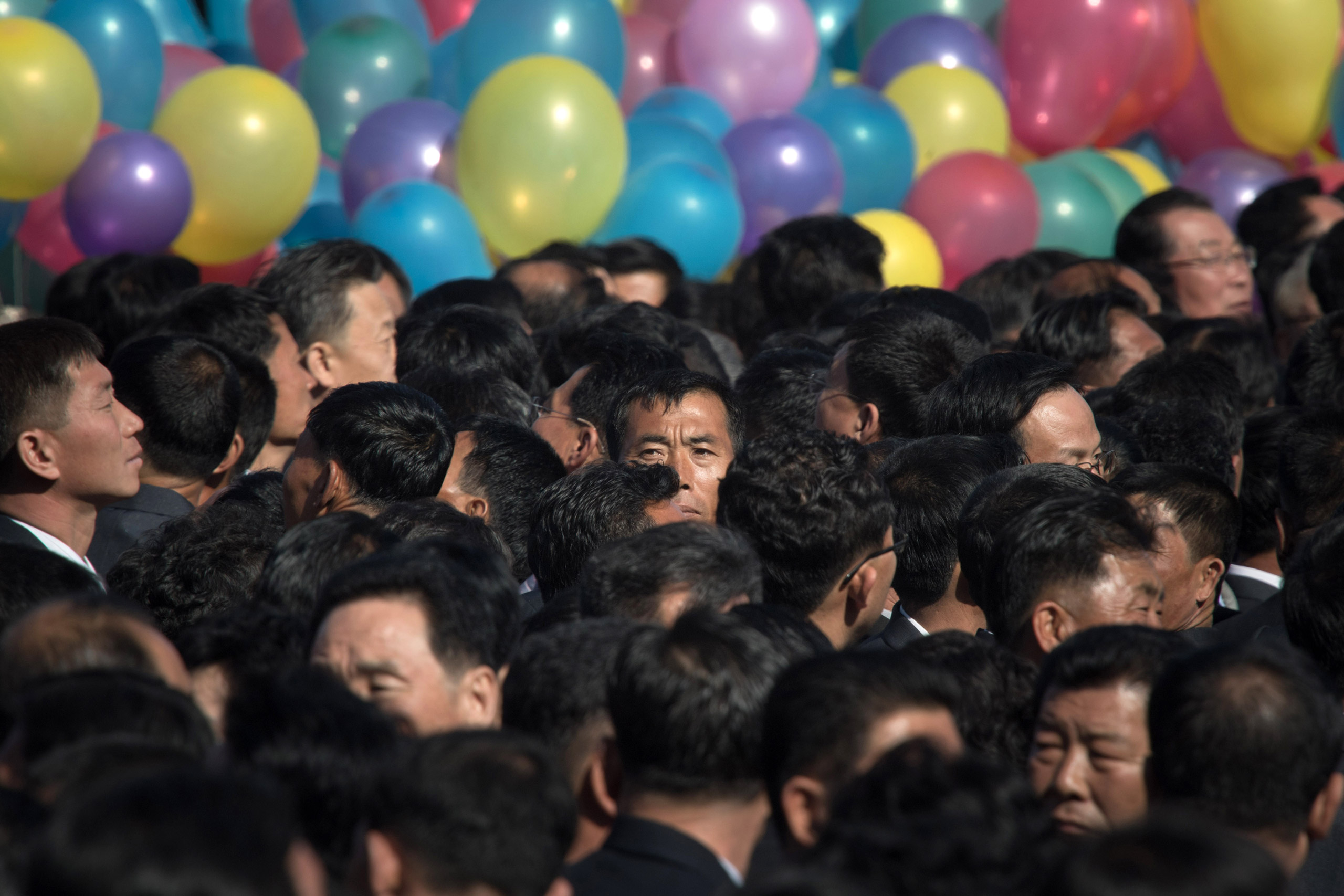 Attendees wait for the opening ceremony for the Ryomyong Street housing development in Pyongyang on April 13, 2017. Completion of the sprawling Ryomyong Street development, just down a wide avenue from the mausoleum where Kim Jong-Un's grandfather Kim Il-Sung and father Kim Jong-Il lie in state, was repeatedly promised in time for the 105th anniversary of the birth of the North's founder.